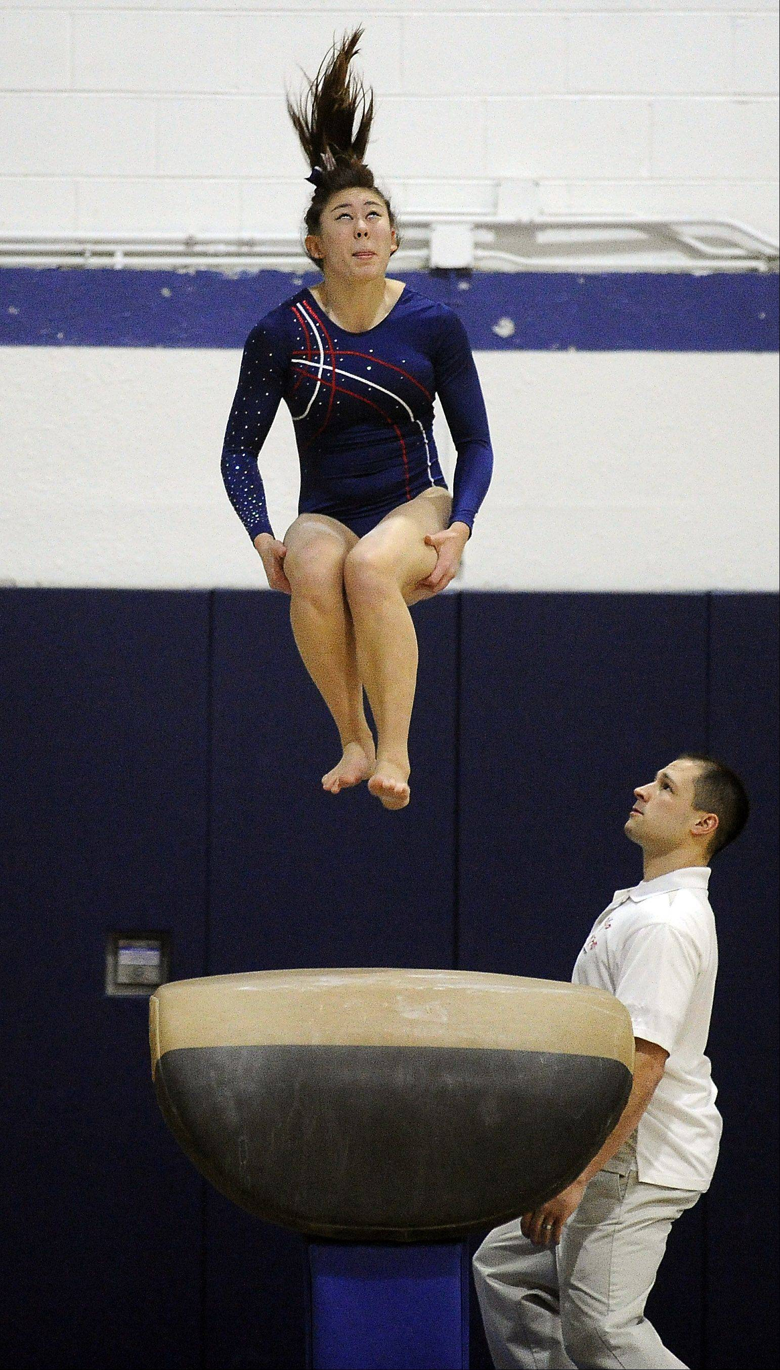 Conant's Meicie Bennett on the vault at Thursday's Conant regional.