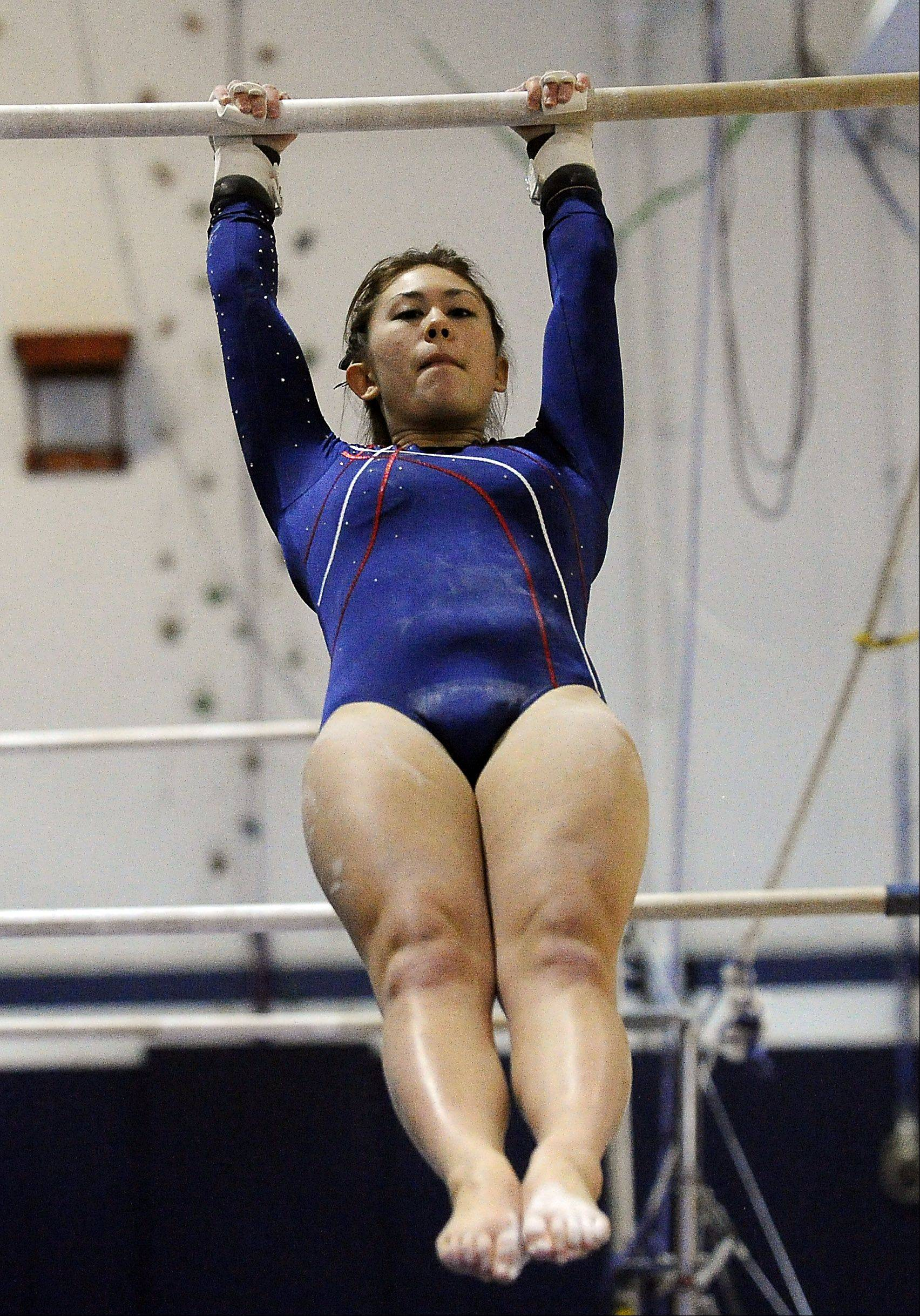 Conant's Meicie Bennett on uneven parallel bars at Thursday's Conant regional.