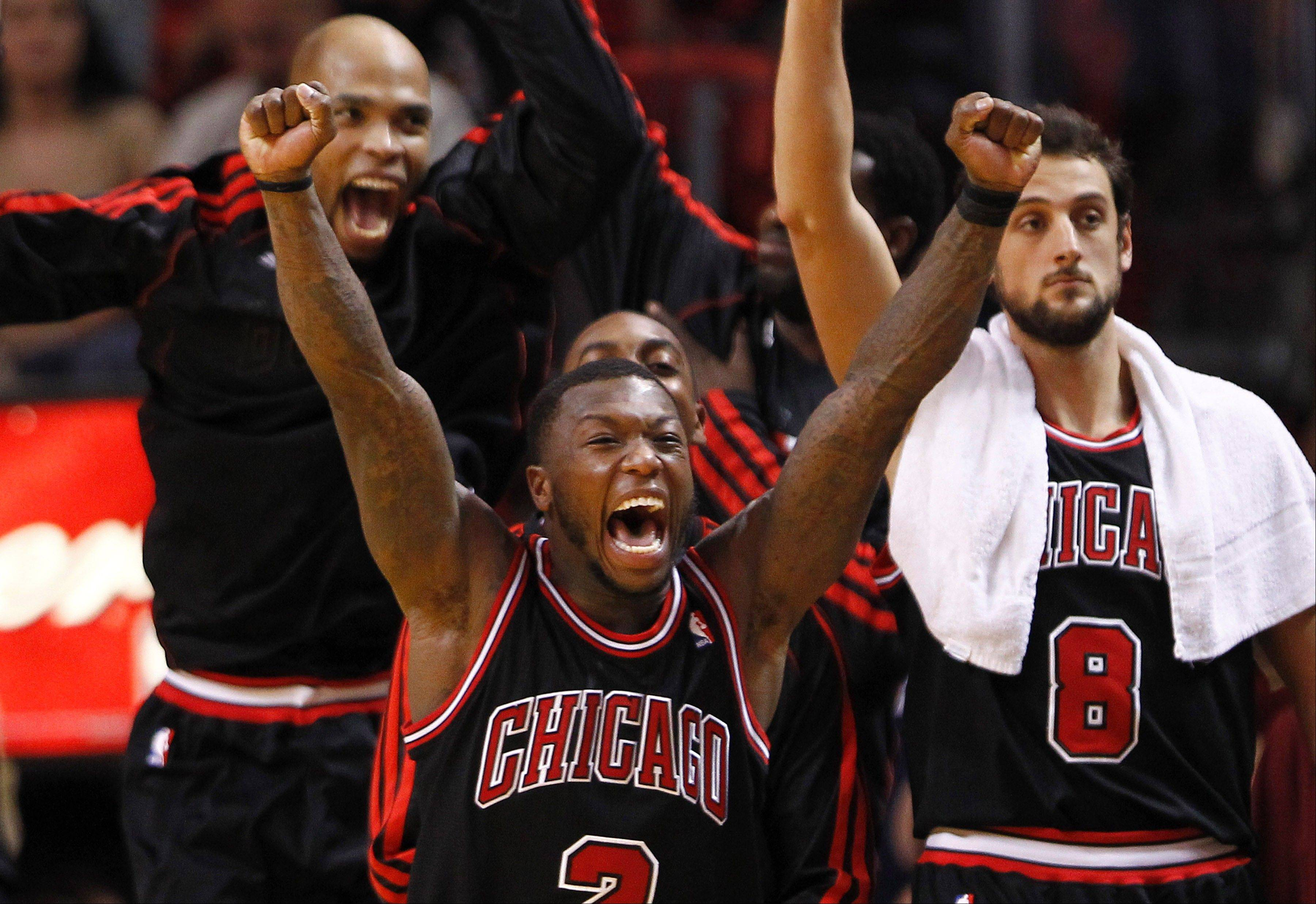 The Bulls' Nate Robinson and his teammates celebrate after beat the Miami Heat on Jan. 4 in Miami.