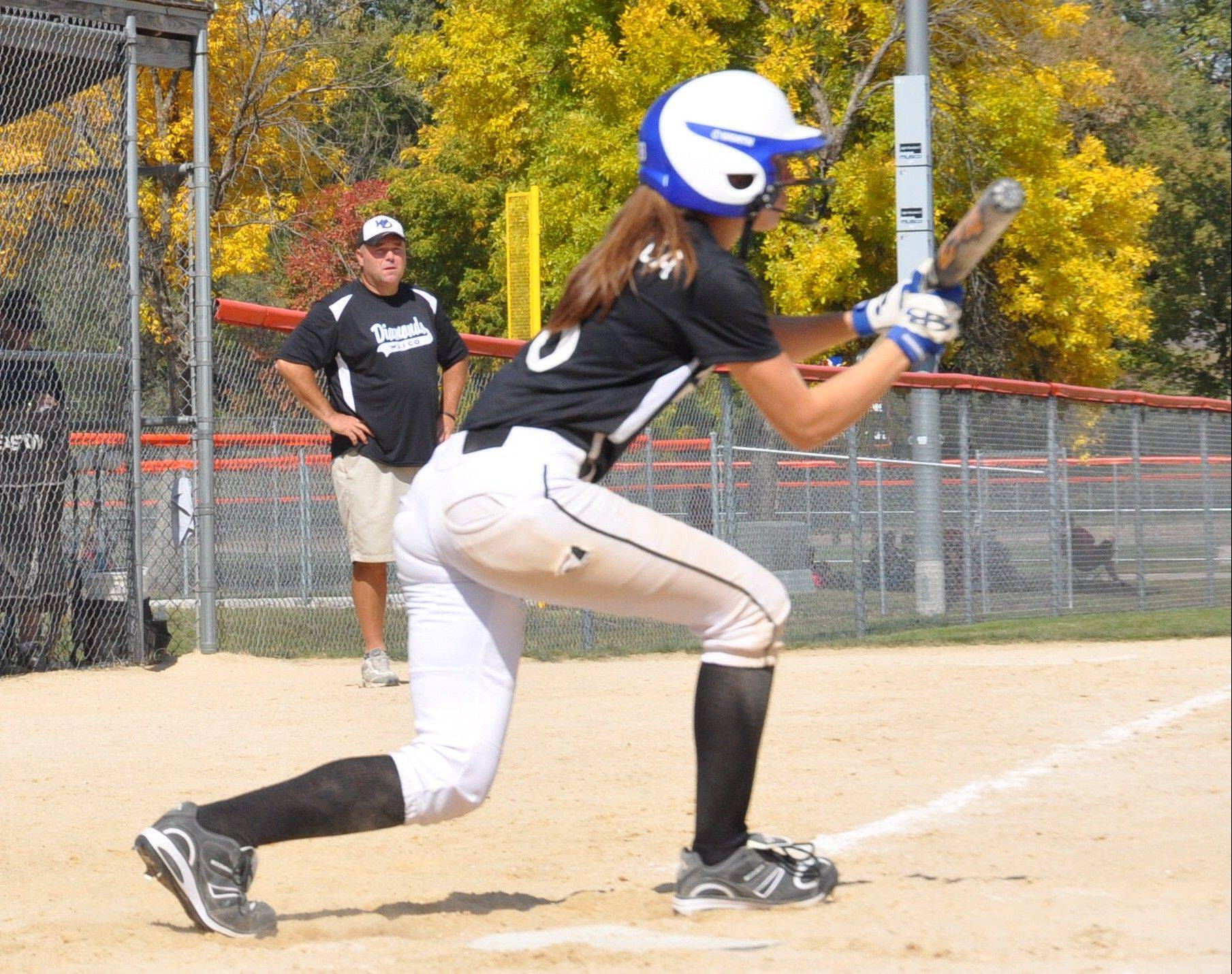 Emma Spagnola, a junior at West Aurora, squares around for a bunt last year for her Wasco Diamonds travel team. The talented two-sport standout decided to play softball in college.
