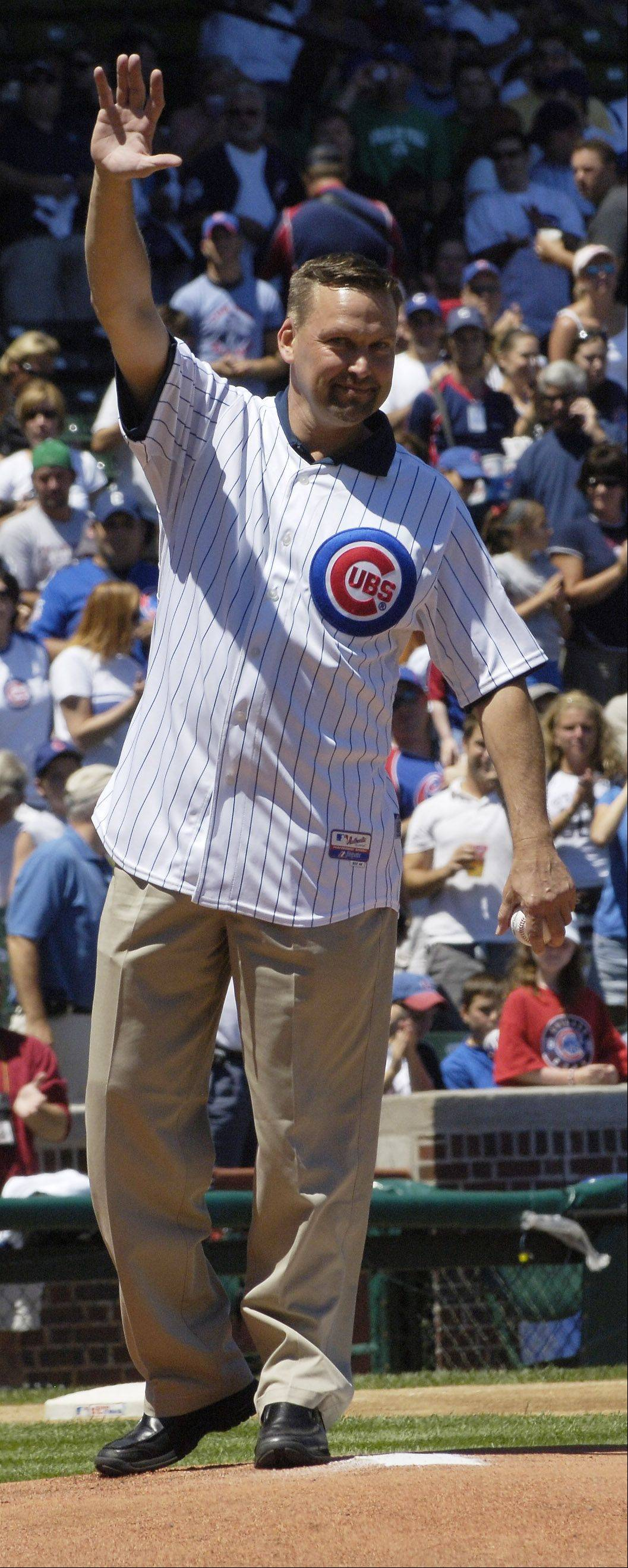 Former Cubs first baseman Mark Grace greets the crowd at Wrigley Field before throwing out the first pitch in 2007 game.