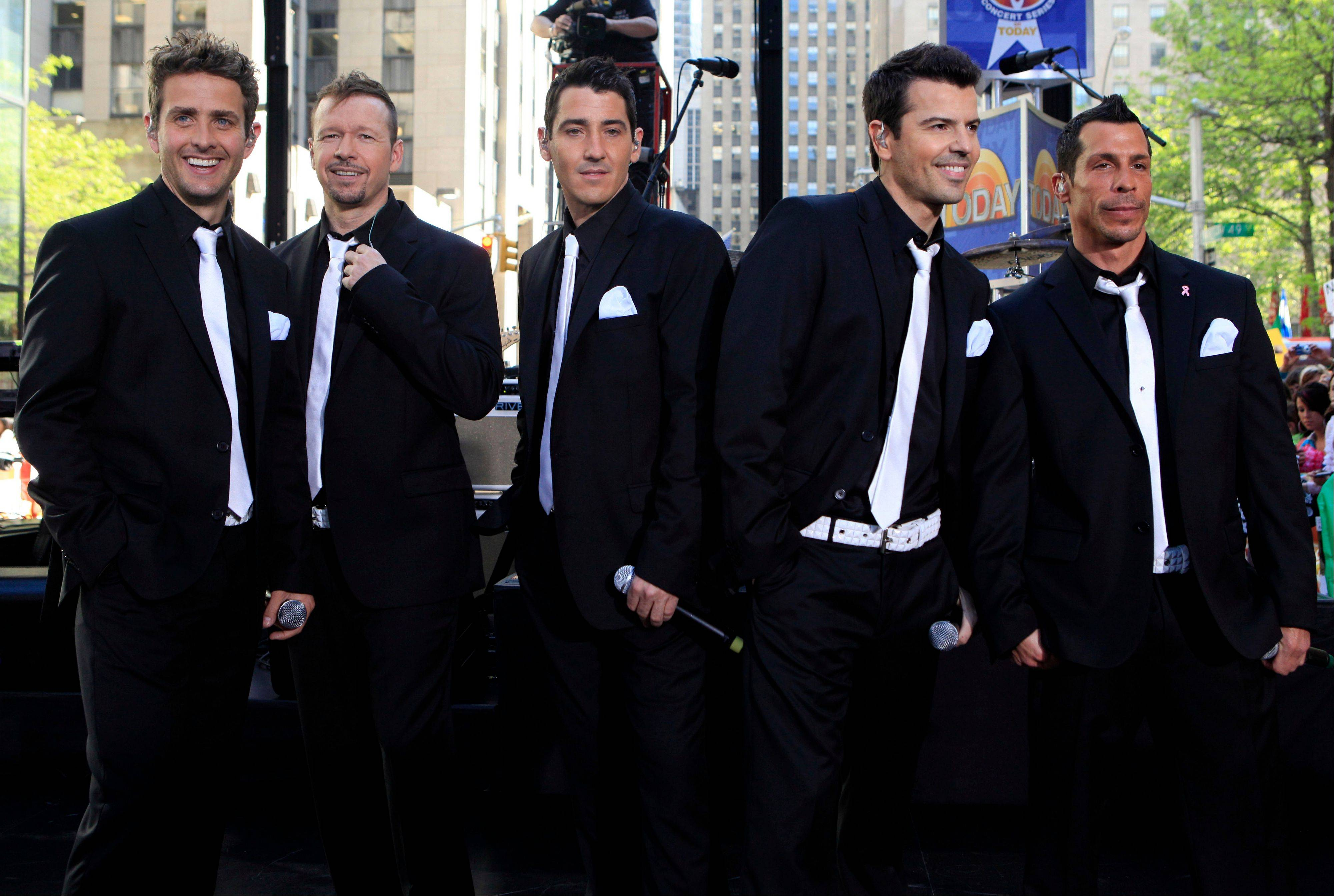 Members of New Kids on the Block — Joey McIntyre, left, Donnie Wahlberg, Jonathan Knight, Jordan Knight and Danny Wood — are teaming up with 98 Degrees and Boyz II Men for a summer tour.