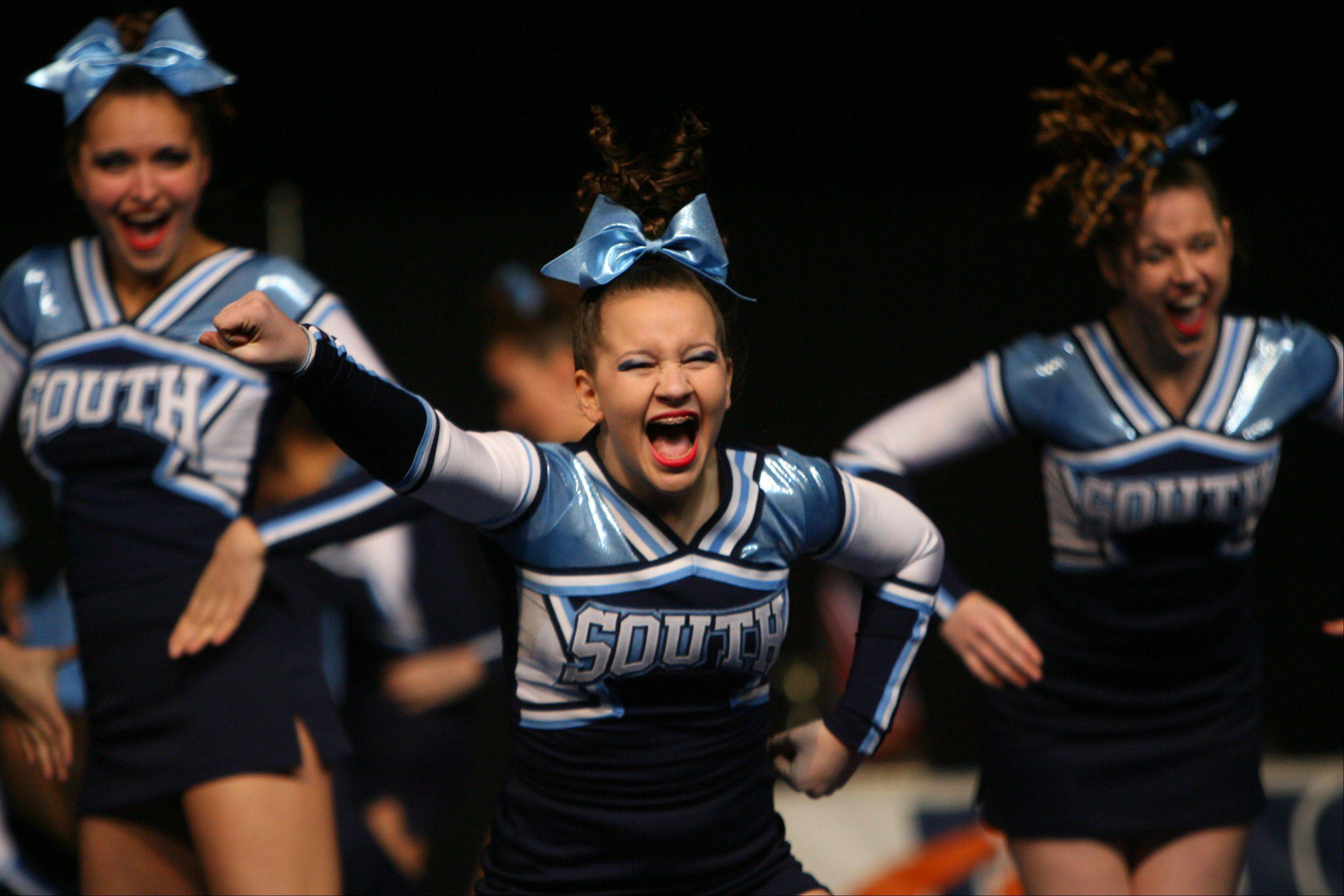 Downers Grove South High School competes in the in the Competitive Cheerleading prelims on Friday at the U.S. Cellular Coliseum in Bloomington.