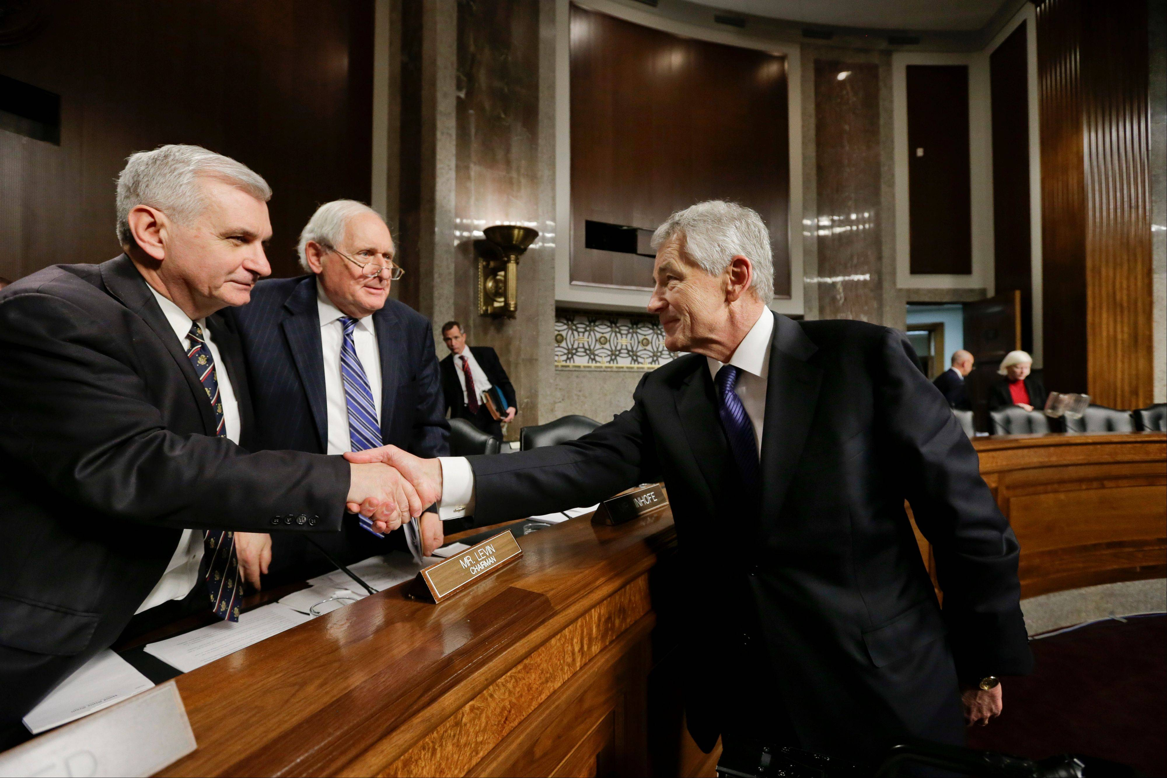 Chuck Hagel, right, President Obama�s nominee to become secretary of defense, shakes hands with Sen. Jack Reed, D-R.I., far left, and Senate Armed Services Committee Chairman Carl Levin, D-Mich., second from left, at the end of his confirmation hearing, on Capitol Hill in Washington, Thursday, Jan. 31, 2013.