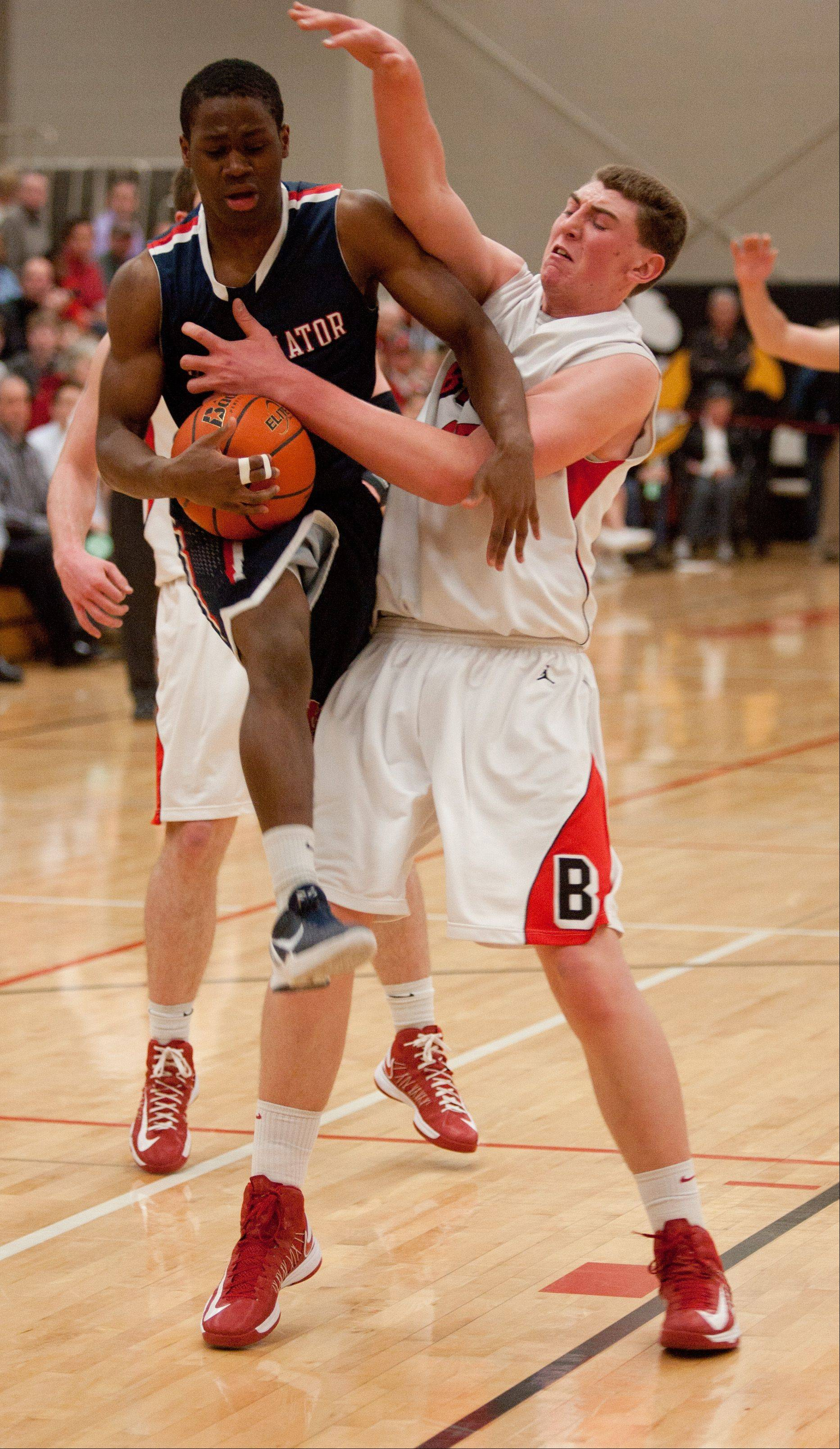 Benet�s Sean O�Mara uses his body against St. Viator during boys basketball action in Lisle.