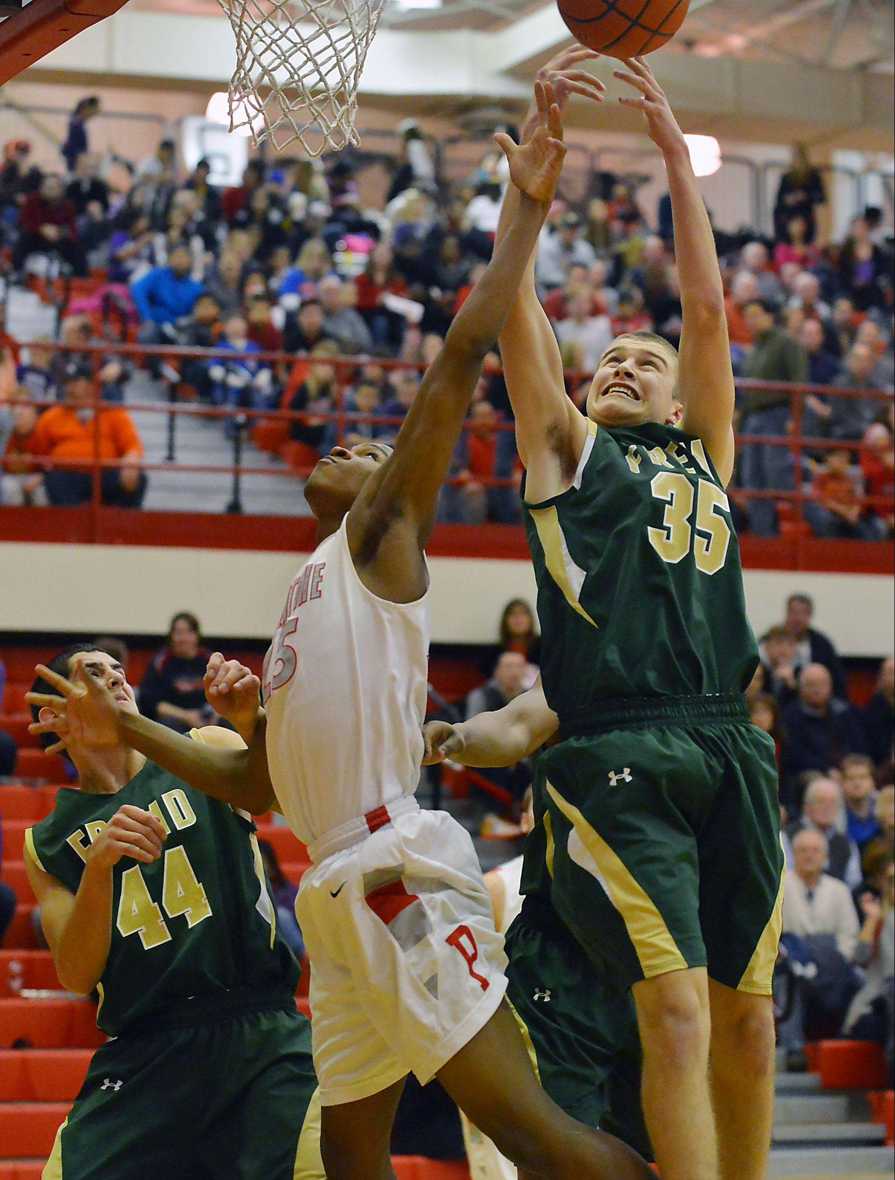 Fremd's Tom Cordell and Palatine's Mike Williams battle for a rebound on Friday night.