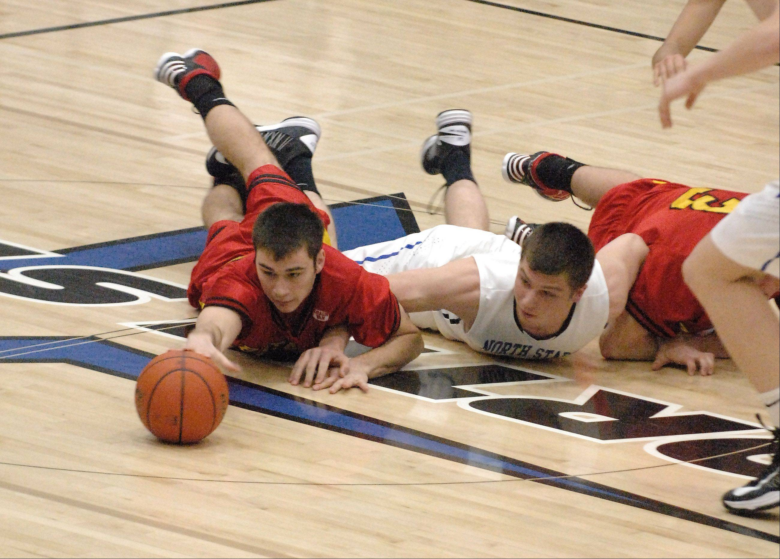 Batavia�s Zach Strittmatter and St. Charles North�s Ryan Thomas hit the deck for a loose ball.