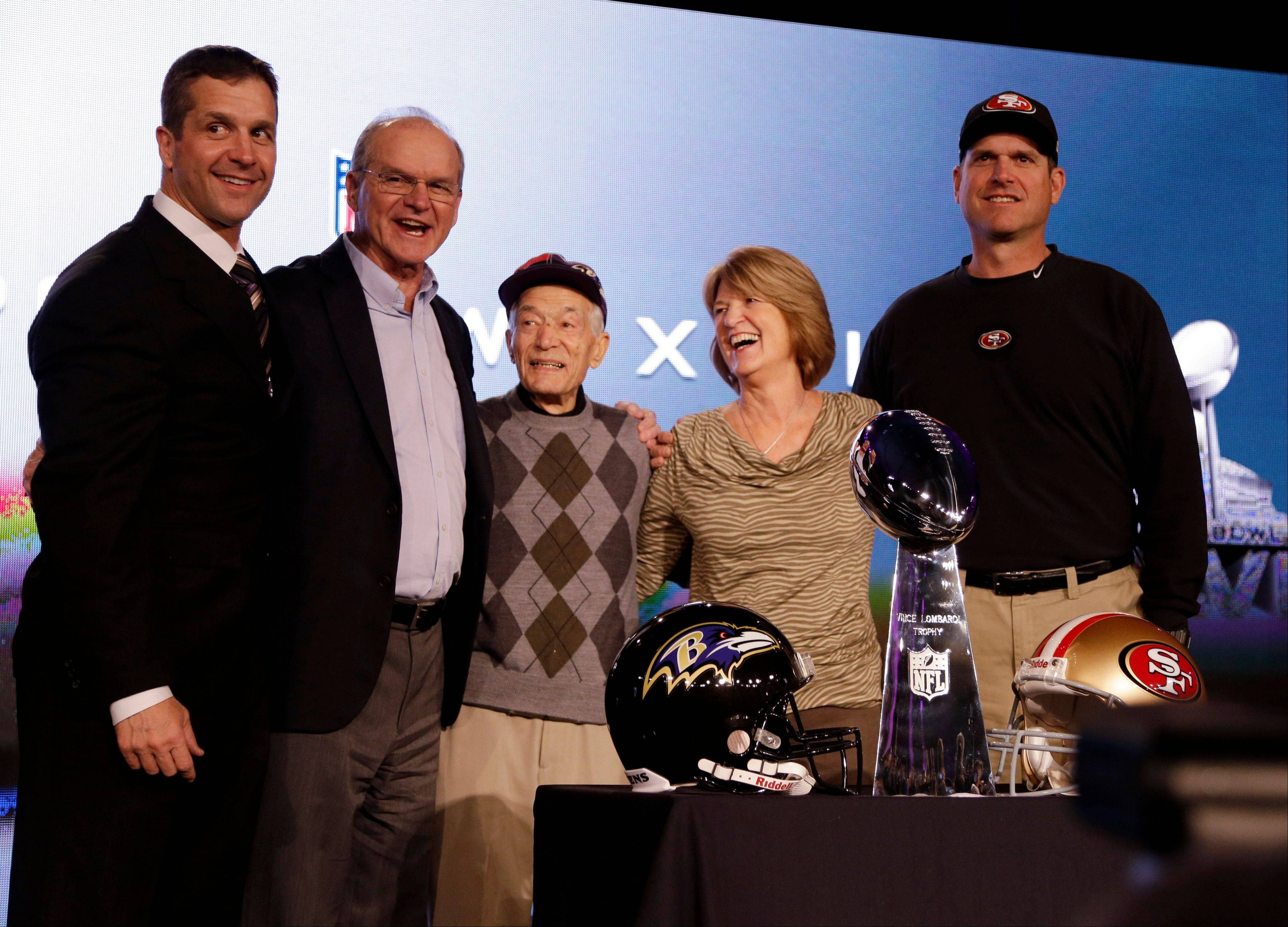 San Francisco 49ers head coach Jim Harbaugh, right, and Baltimore Ravens head coach John Harbaugh, left, pose with their parents, Jack and Jackie, and grandfather Joe Cipiti during a news conference for the NFL Super Bowl XLVII football game Friday, Feb. 1, 2013, in New Orleans.