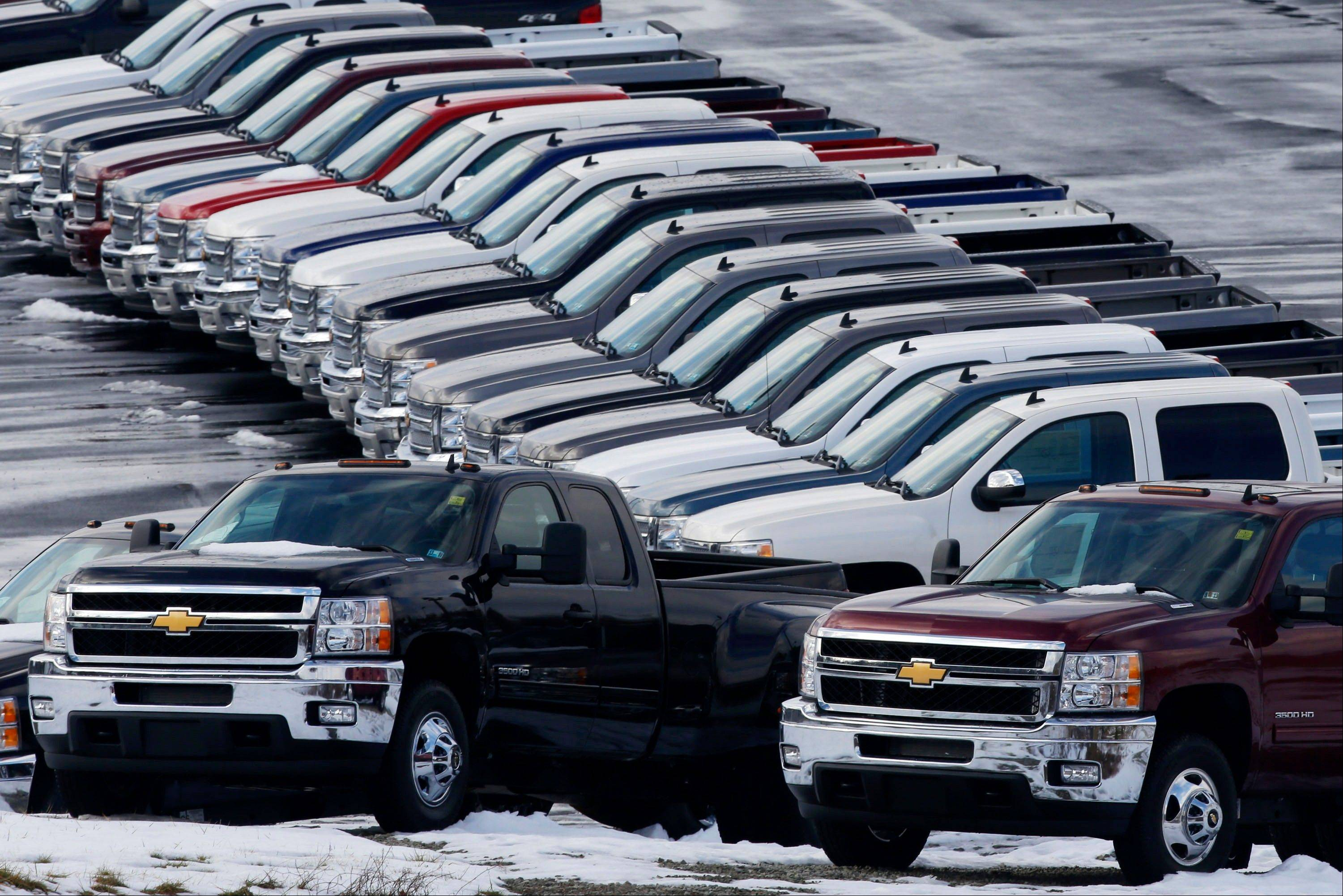 Chevy trucks line the lot of a dealer in Murrysville, Pa. Ford, Chrysler and General Motors all reported double-digit gains for January as last year's momentum in U.S. auto sales continued into 2013.