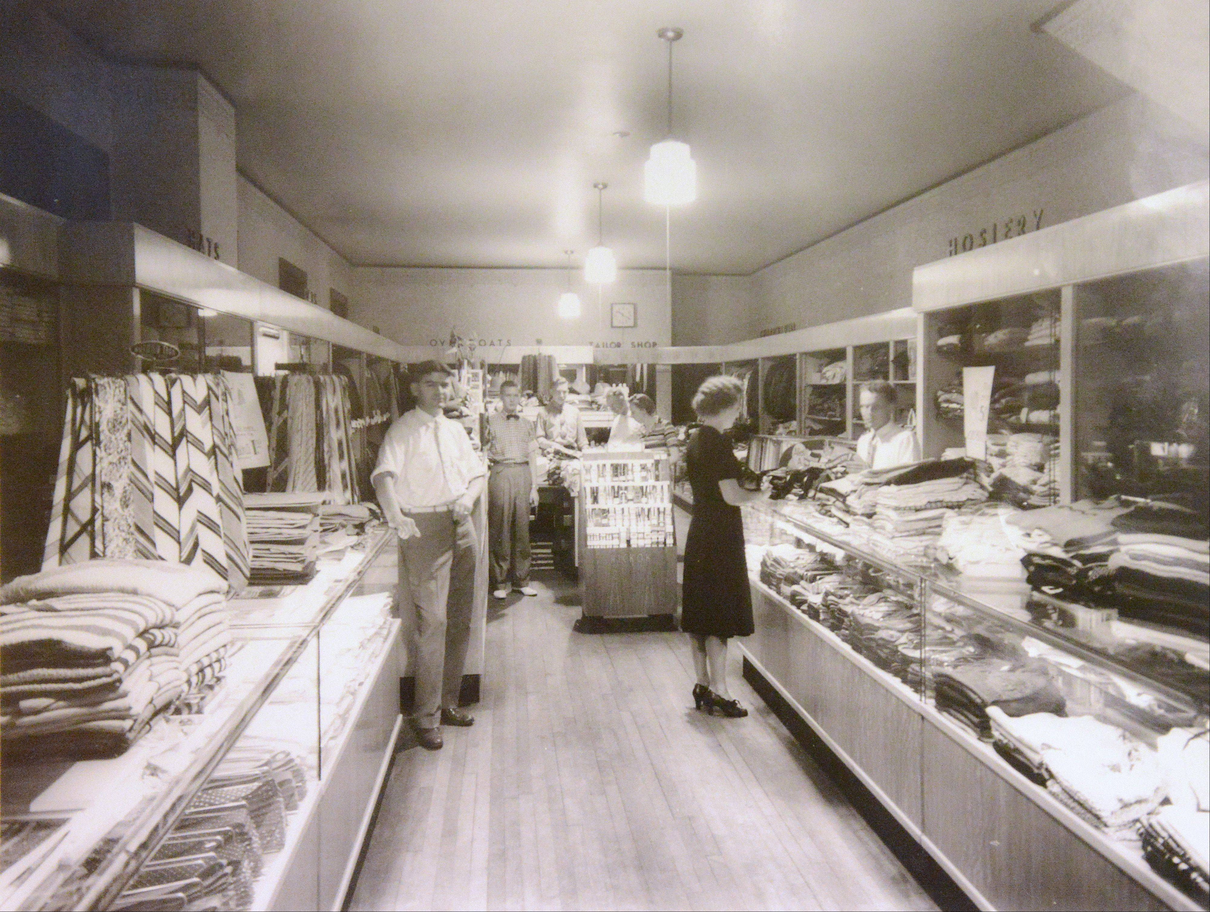 Victor Erday Sr., at left, is shown in the store he opened in 1925. The family store in downtown Geneva is closing after nearly 88 years in business.