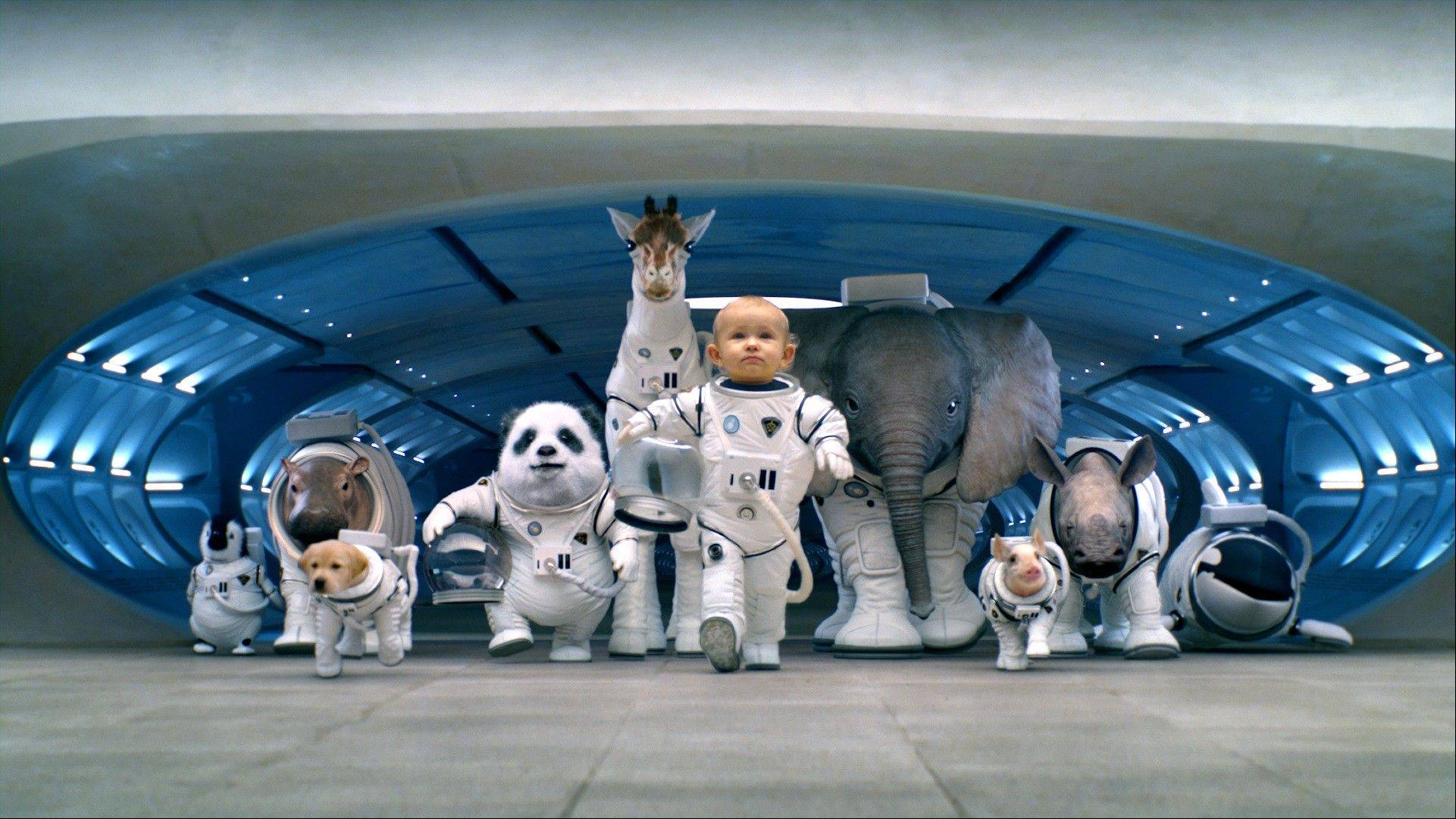 "The Super Bowl advertisement by Hyundai Motor Group's Kia. In the advertisment, Kia invents a fanciful way that babies are made, blasting in from a baby planet in its ""Space babies"" ad for the 2014 Sorento crossover."