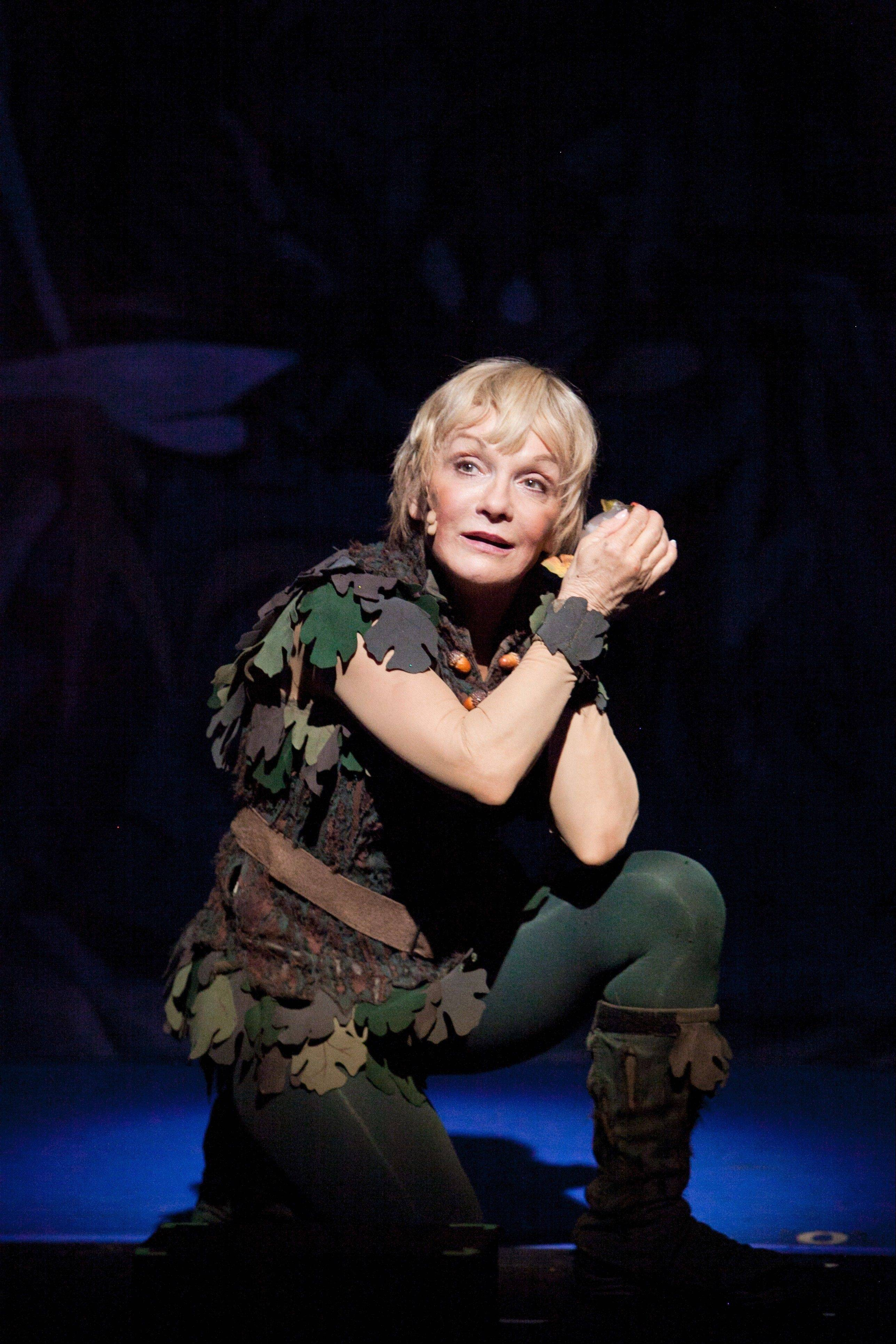 "Peter Pan (Cathy Rigby) seeks help for the ailing fairy Tinkerbell in the national tour of ""Peter Pan,"" now playing the Cadillac Palace Theatre in Chicago through Sunday, Feb. 10."