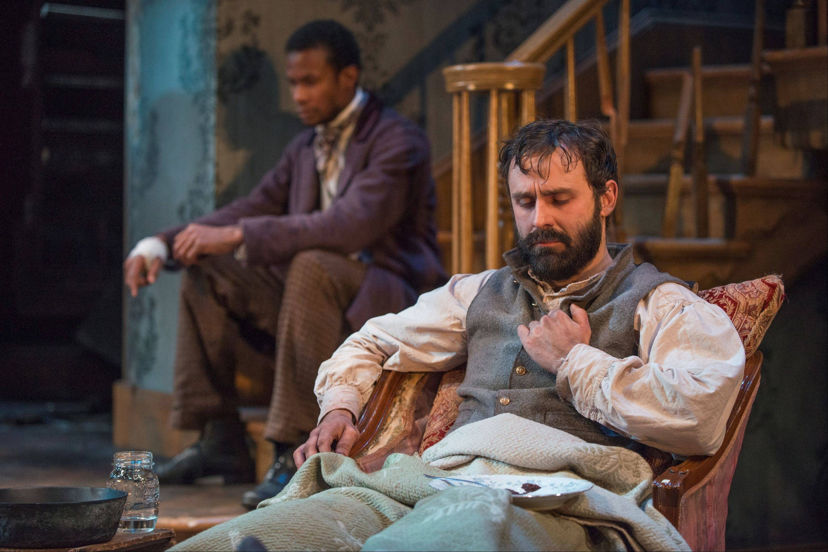 "Their shared Jewish faith unites Confederate soldier Caleb (Derek Gaspar, right) and his family's former slave John (Sean Parris, upstage), but race divides them in Matthew Lopez's ""The Whipping Man"" running through Feb. 24 at Northlight Theatre."