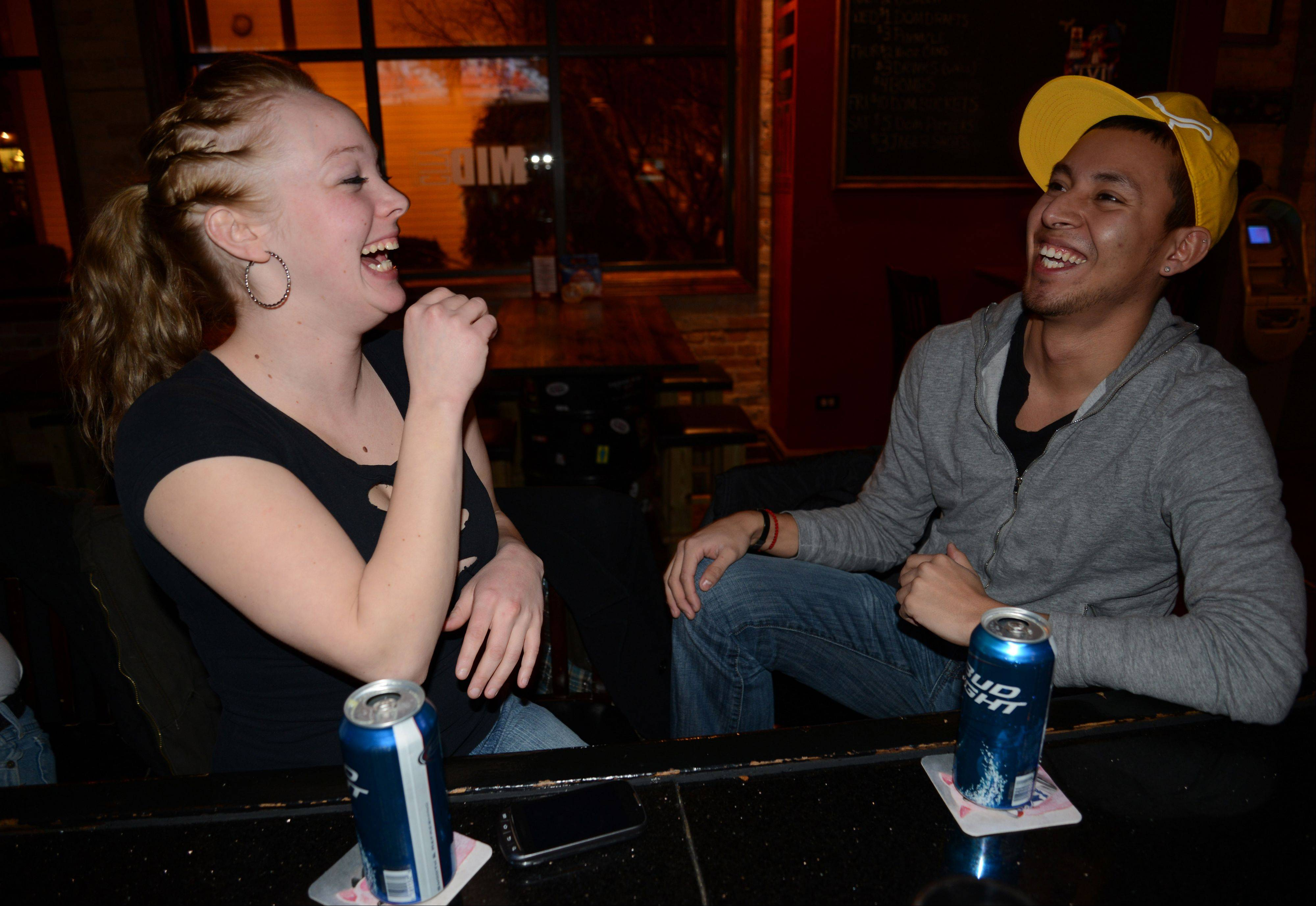 Samantha Burkhart and Erick Mariano both of West Chicago share a laugh at Midcity Cocktails & Supper Club.