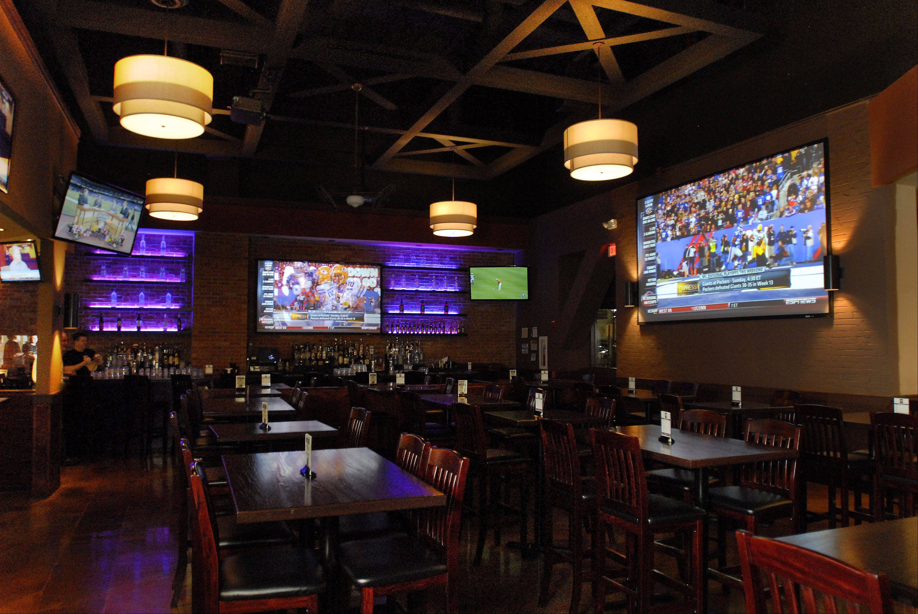 Massive screens put you close to the Super Bowl action at Wickets Bar and Grill in Schaumburg.