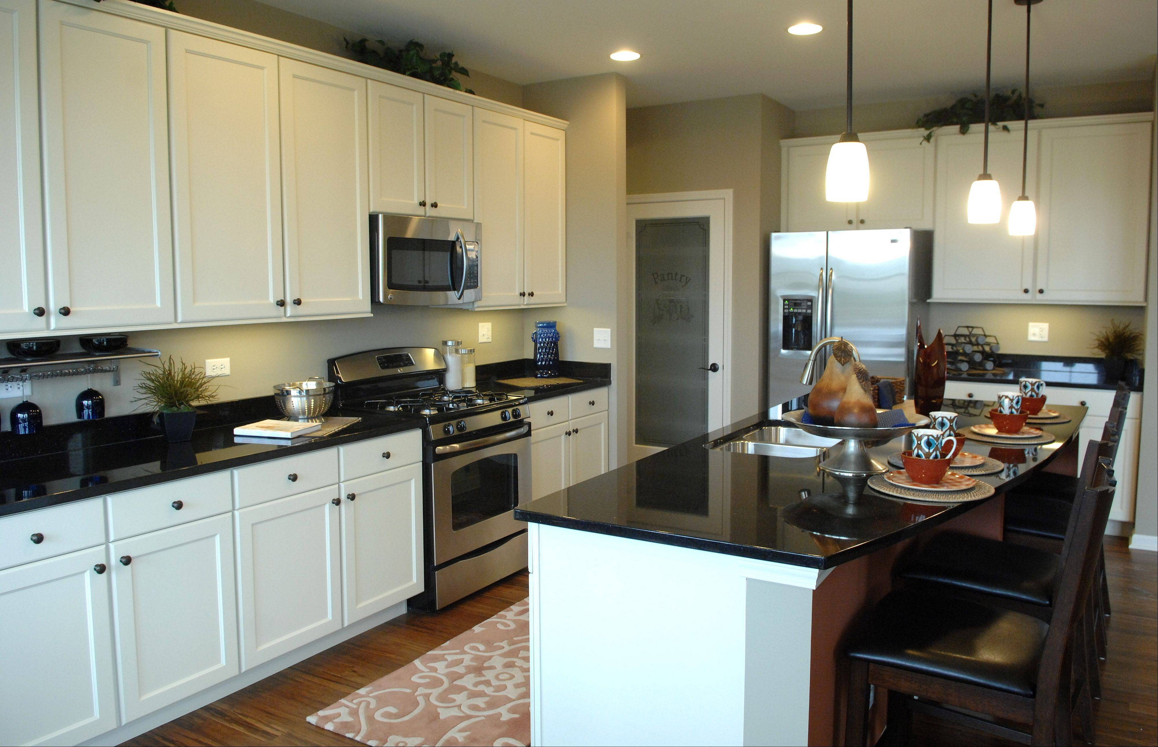 The kitchen island and adjoining breakfast area can accommodate seating for 12.