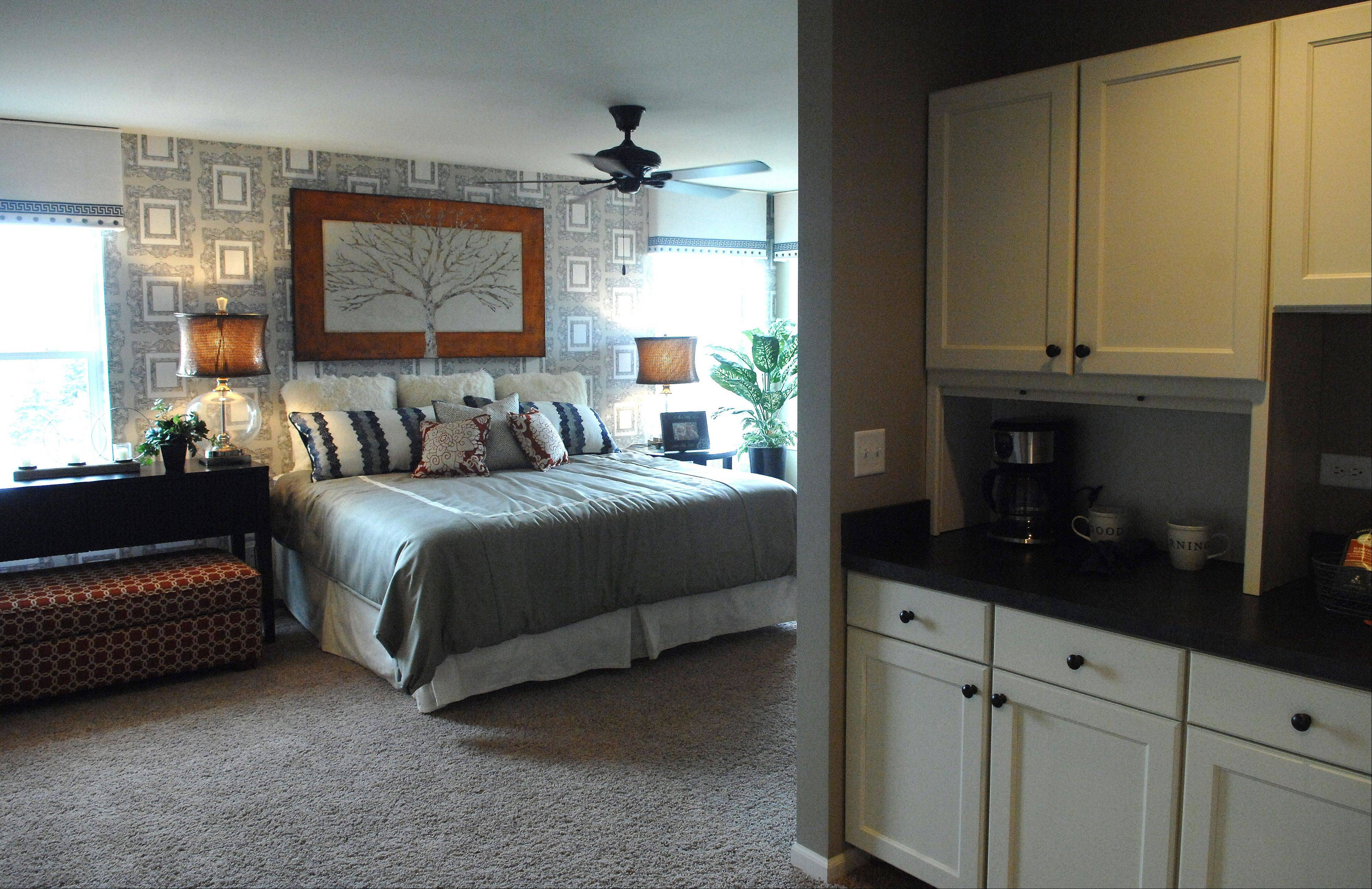 A coffee bar and cabinets make up an enclave in the master suite of the decorated model.