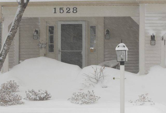 A snowdrift block the front door of this St. Charles after the blizzard of 2011 hit the Chicago area.