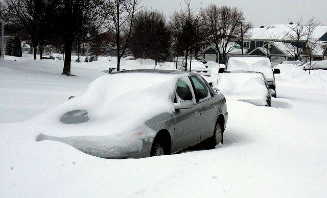 Parked cars buried in snow along Prarieview in Aurora after the blizzard on Wednesday.
