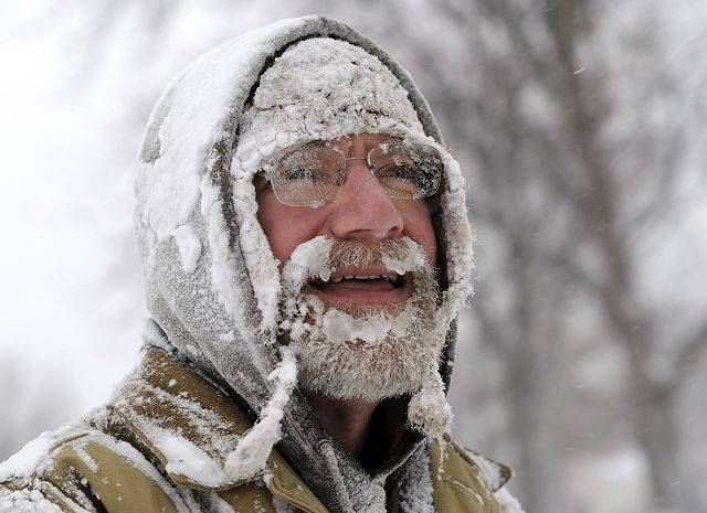 Mark Hamlen of Palatine is a bit frosty after using his snowblower at his house.