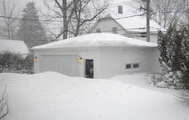 Drifts block garage doors Wednesday morning in Arlington Heights.