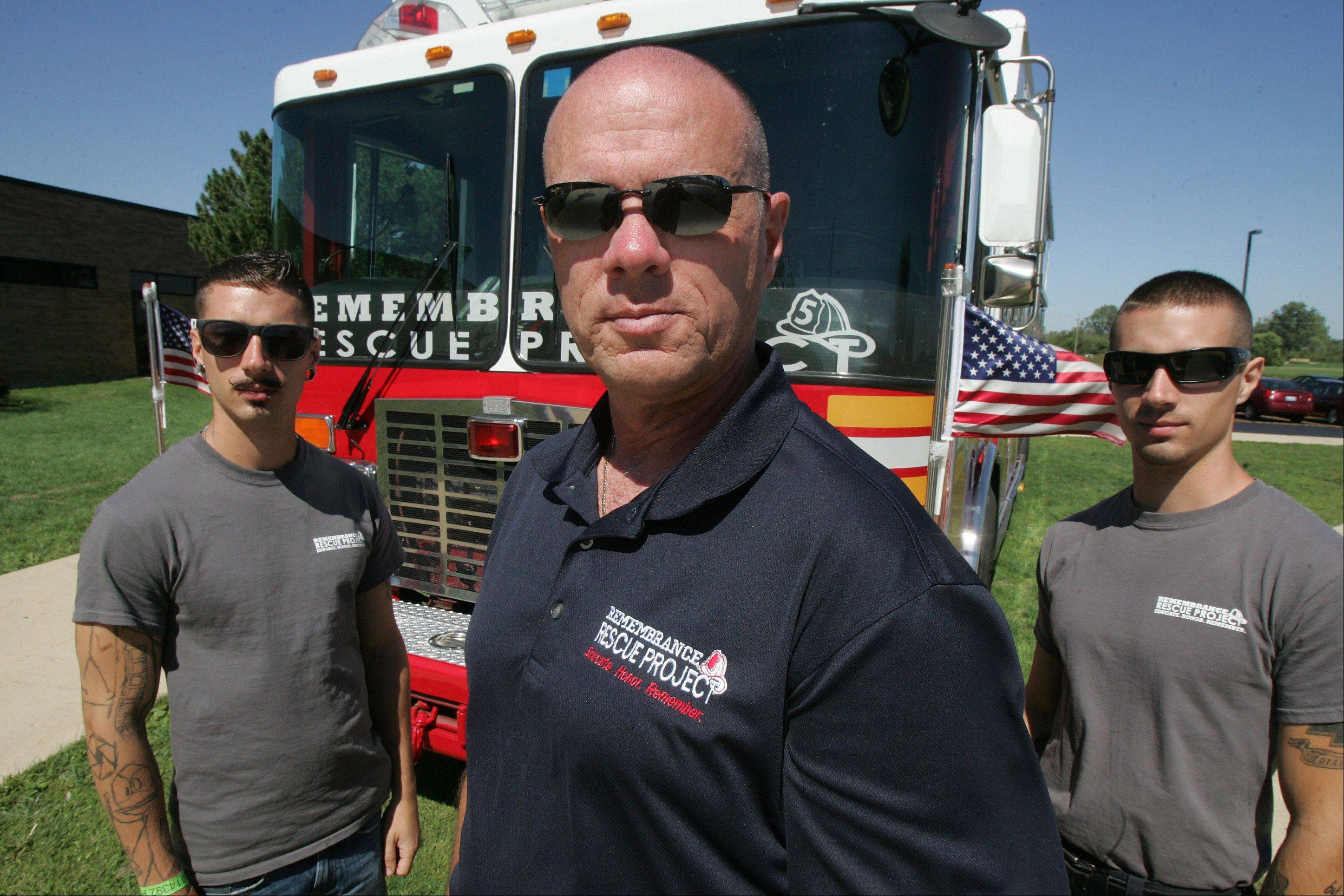 Scott Vaughn of the Remembrance Rescue Project with his sons, Corey and Brian, in front of the New York Fire Department Rescue 5 engine, which was on display during a 9/11 ceremony at the Lake County High Schools Technology Campus in Grayslake. The fire truck was on the scene in New York on Sept. 11, 2001, when the two World Trade Center towers collapsed.