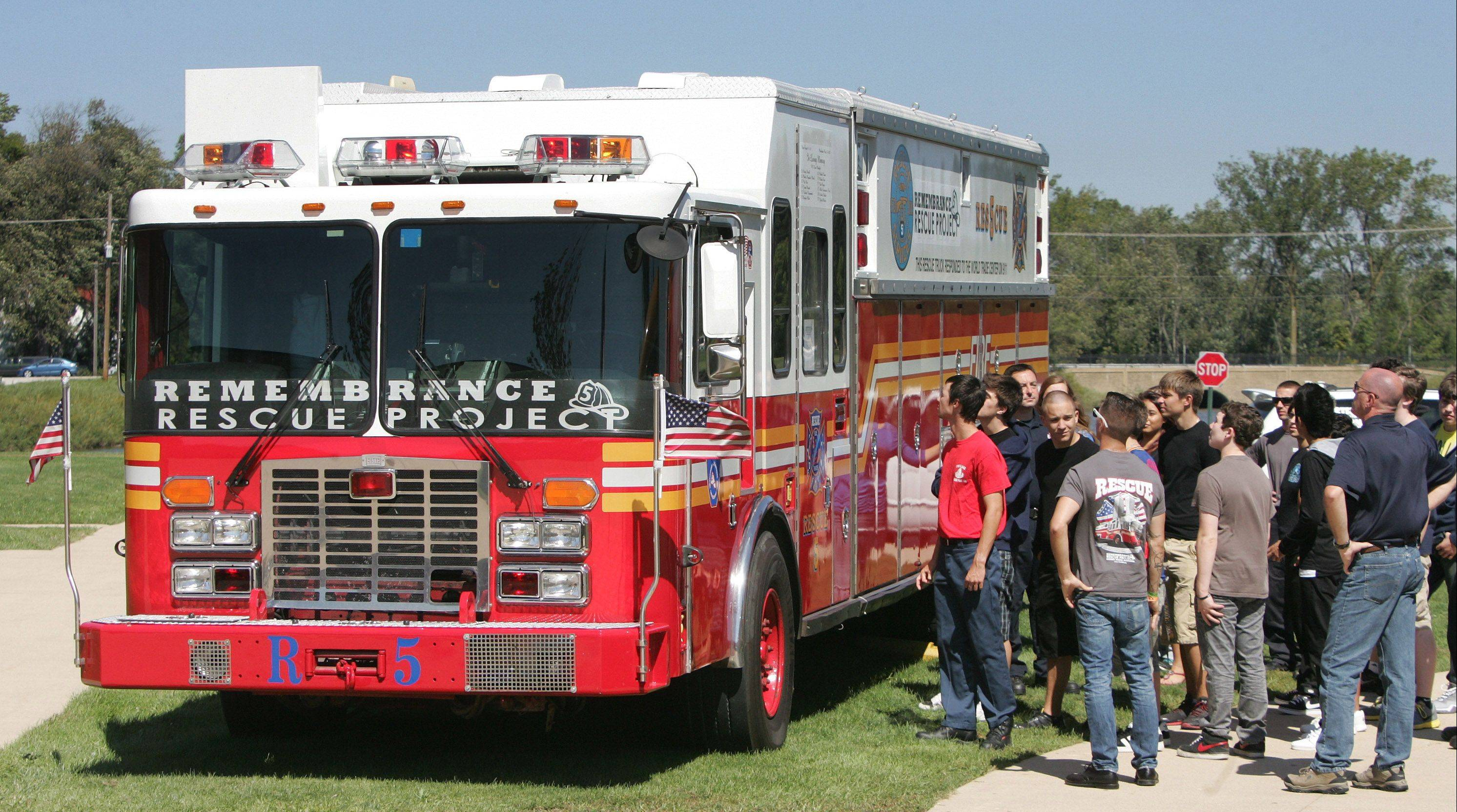 A fire service class looks at New York Fire Department Rescue 5 engine on display during a 9/11 ceremony at the Lake County High Schools Technology Campus in Grayslake. The truck was restored by Remembrance Rescue Project and travels the area to discuss the event.   The fire truck was on the scene in New York on Sept. 11, 2001, when the two World Trade Center towers collapsed. All 11 firefighters with the truck at the time lost their lives.