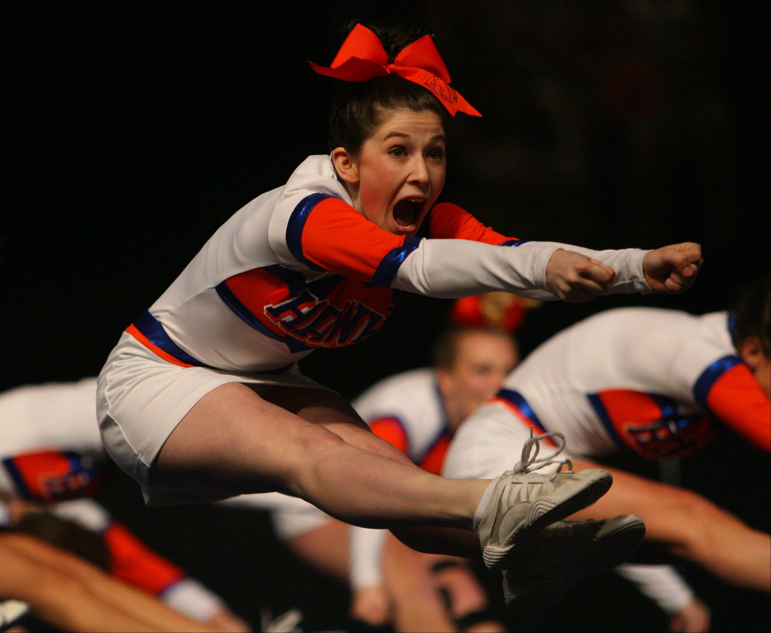 Hoffman Estates High School cheerleaders give a highflying performance Friday in the state final preliminaries.