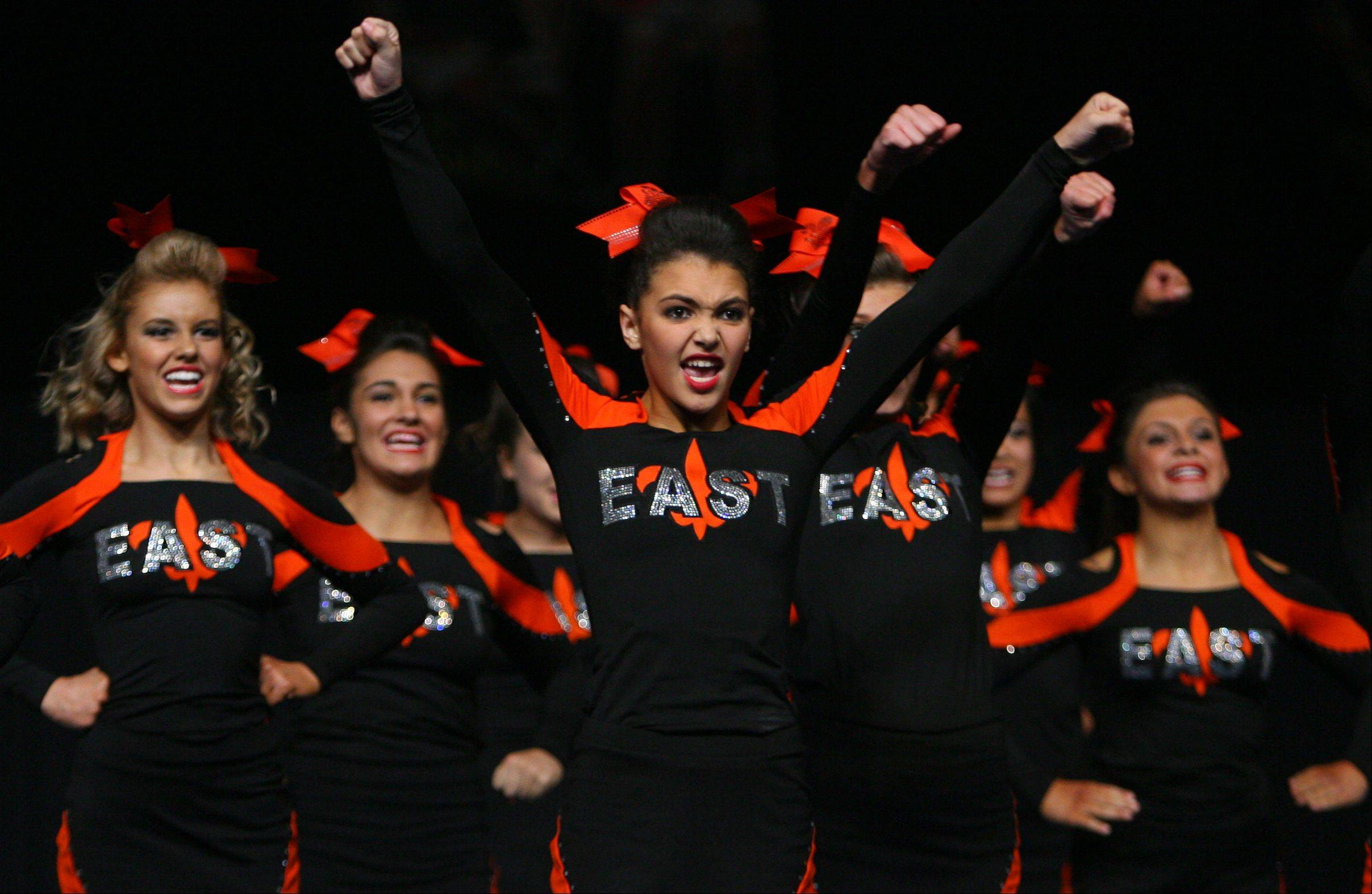 St. Charles East High School tied for seventh place in the competitive cheerleading prelims on Friday and will compete for the large school state title on Saturday.