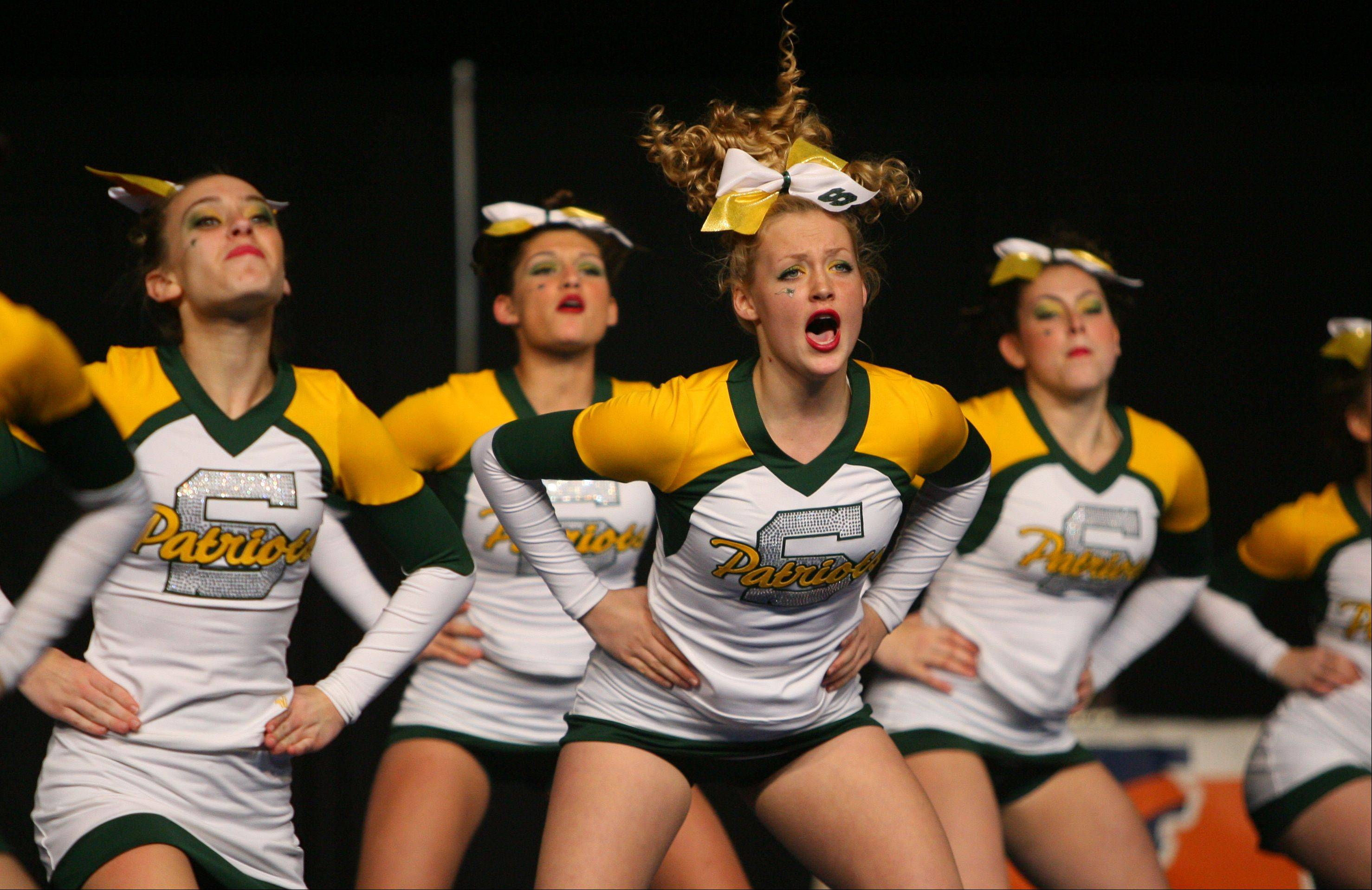 Stevenson High School competes in the in the Competitive Cheerleading prelims on Friday at the U.S. Cellular Coliseum in Bloomington.