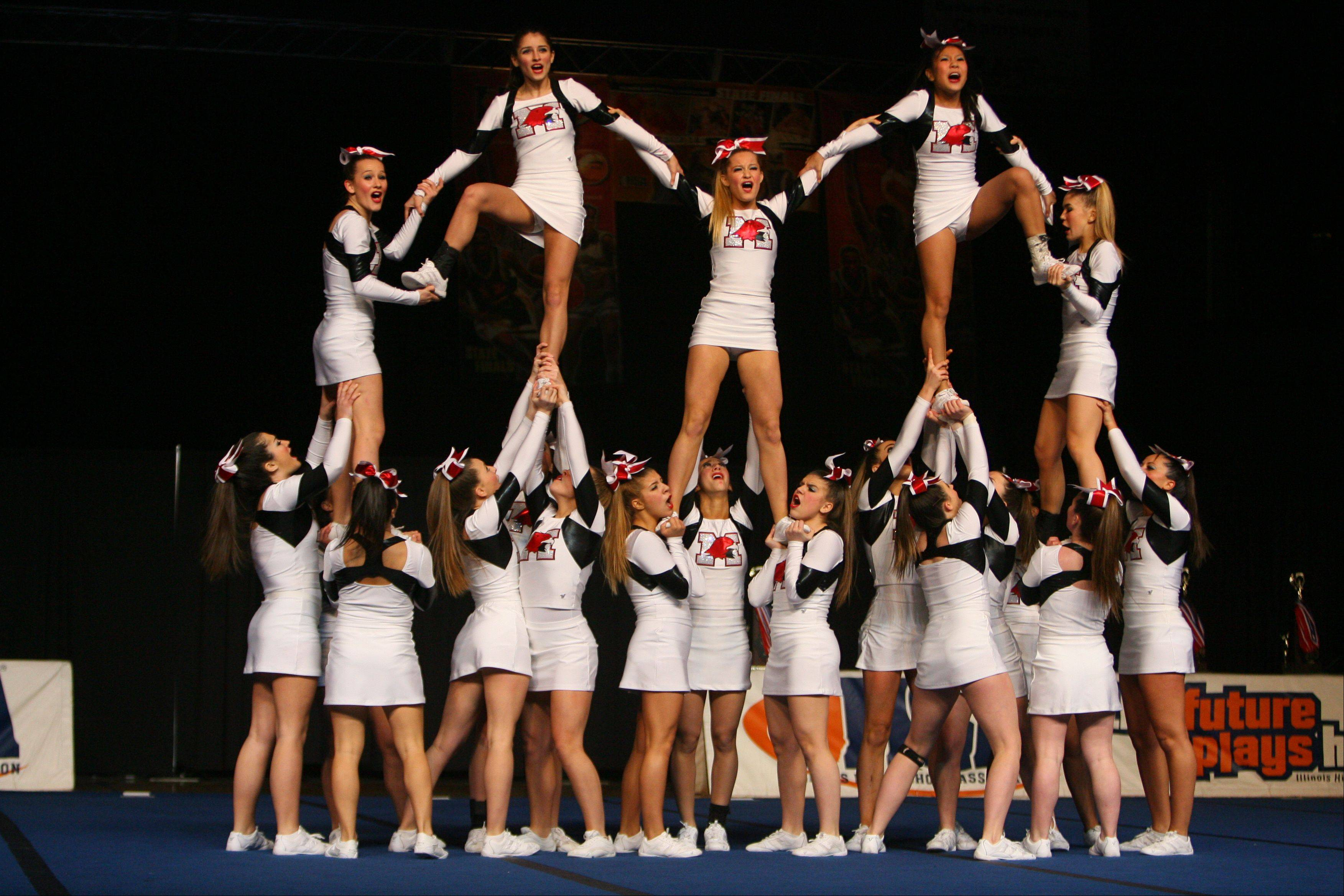 Maine South competes in the in the Competitive Cheerleading prelims on Friday at the U.S. Cellular Coliseum in Bloomington.