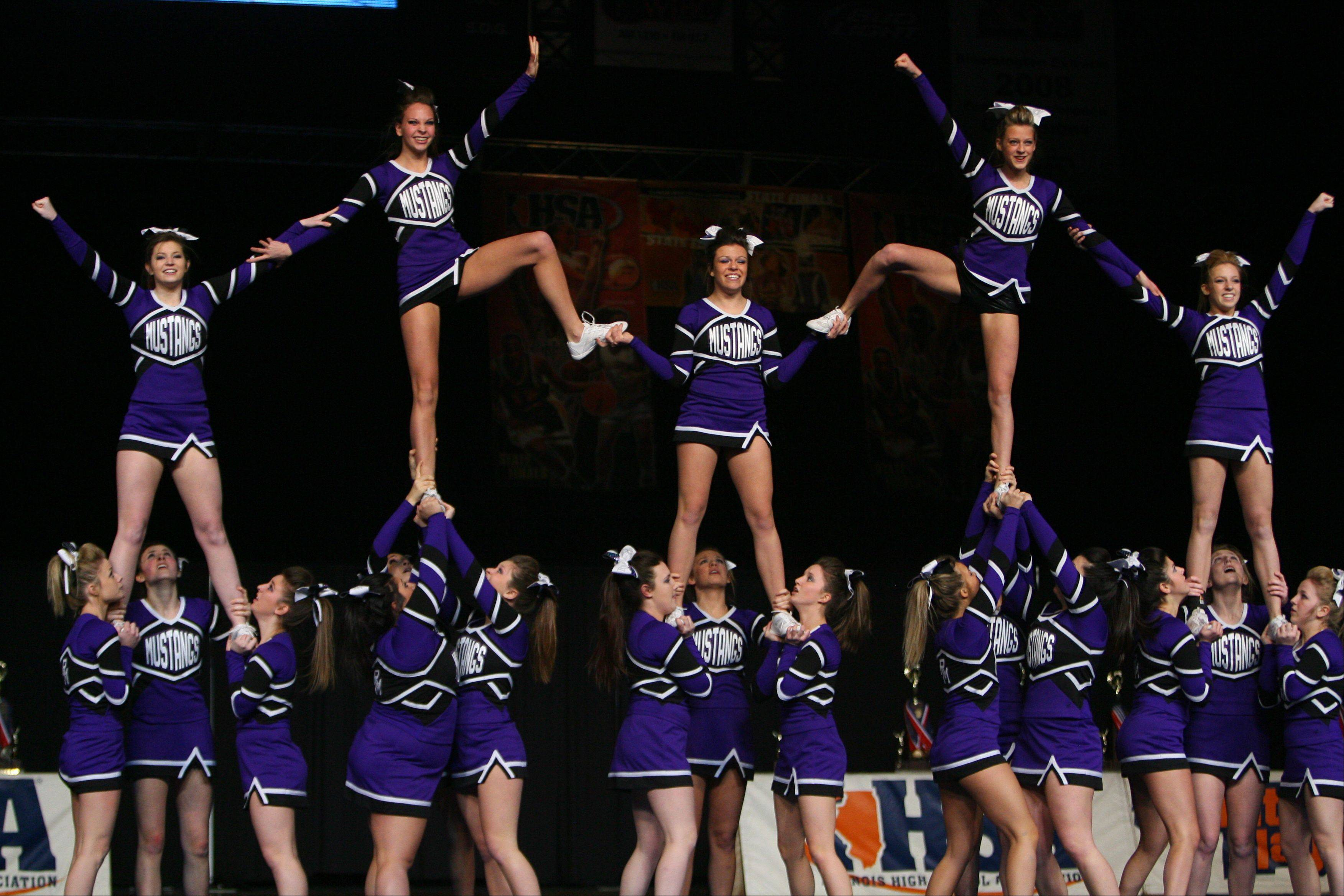 Rolling Meadows High School competes in the in the Competitive Cheerleading prelims on Friday at the U.S. Cellular Coliseum in Bloomington.