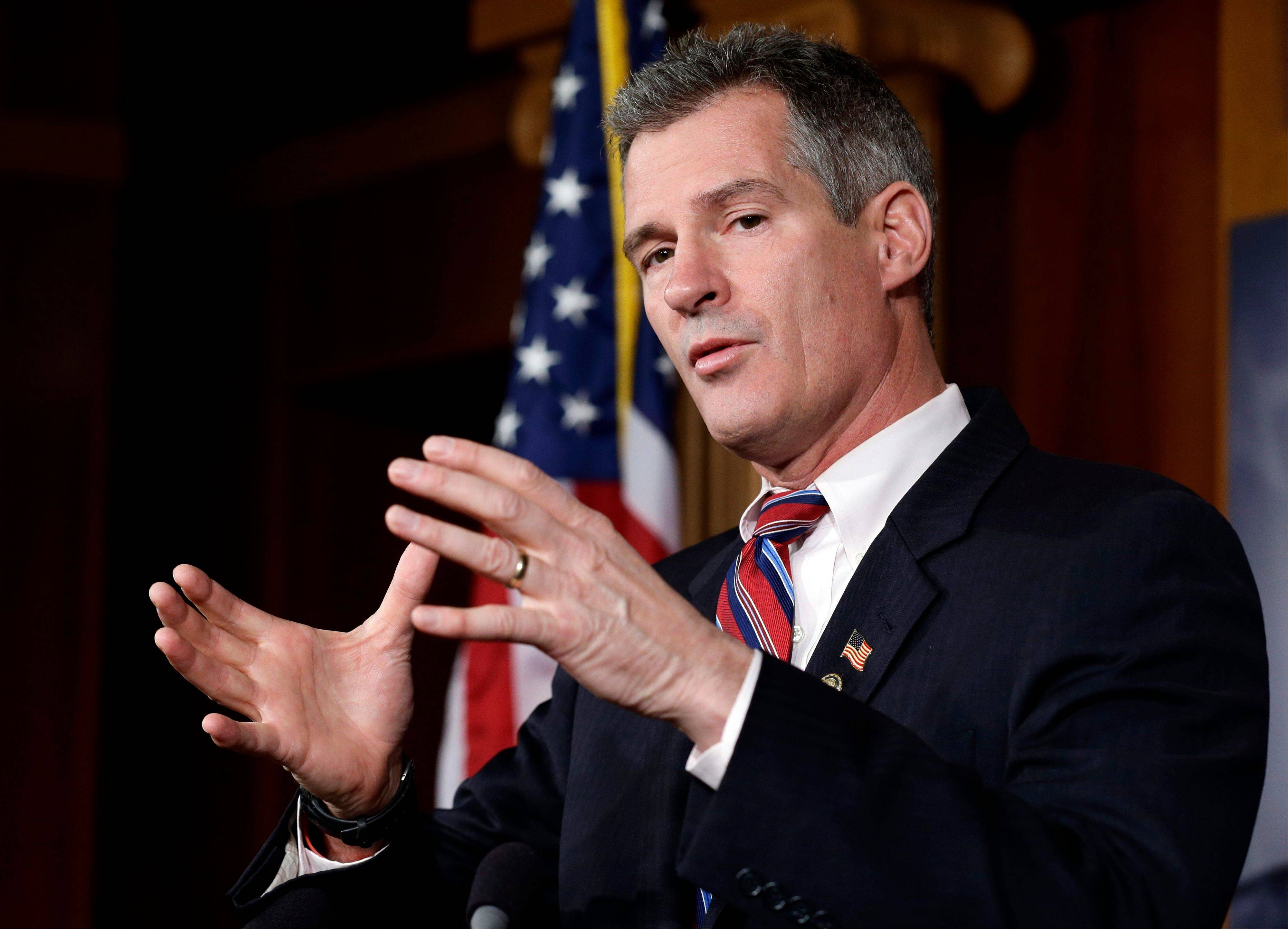 Former GOP Sen. Scott Brown of Massachusetts speaks during a media availability, on Capitol Hill in Washington.