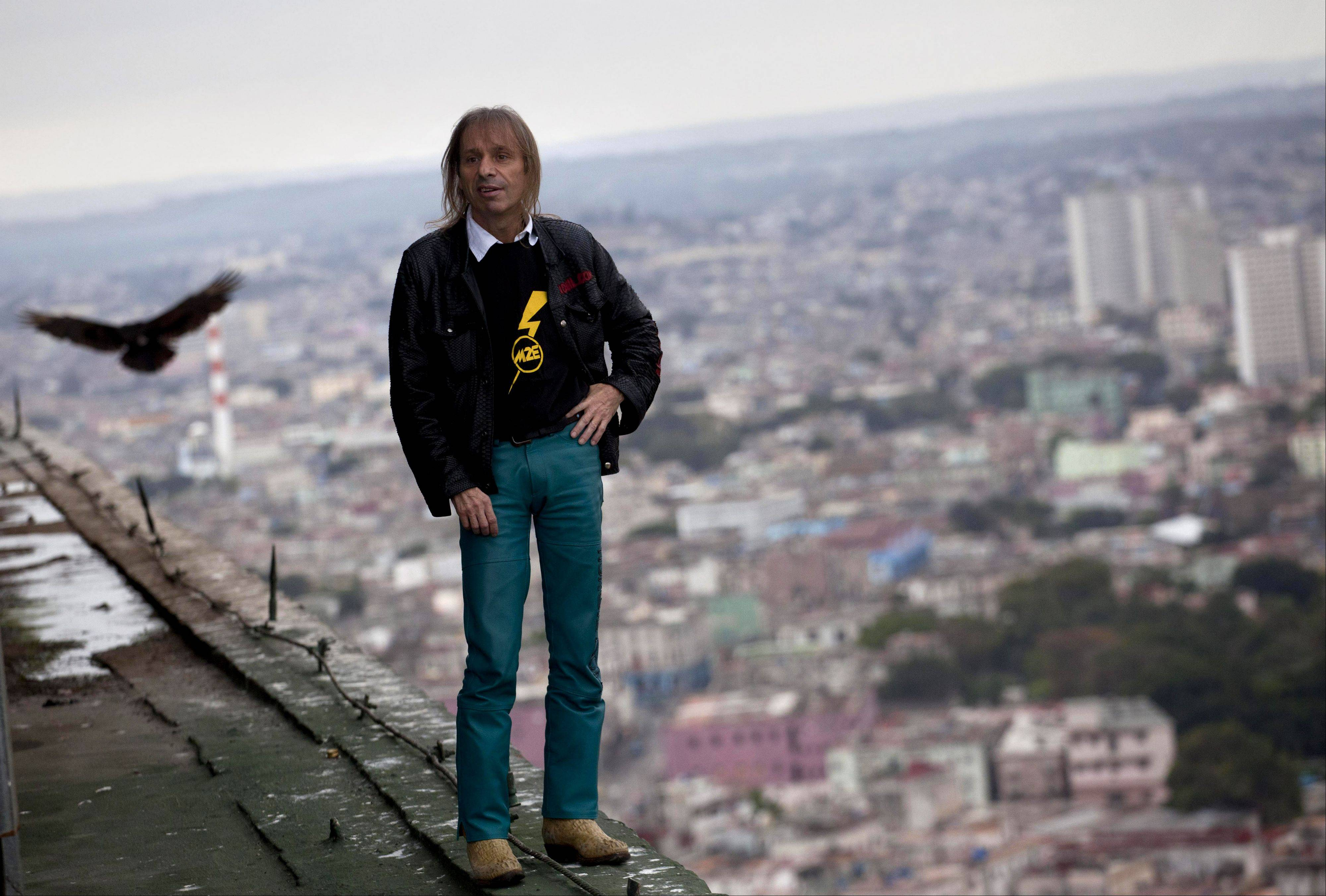 "Alain Robert, known as ""Spiderman,"" poses for a portrait from the roof Friday of the Habana Libre hotel in Havana, Cuba."
