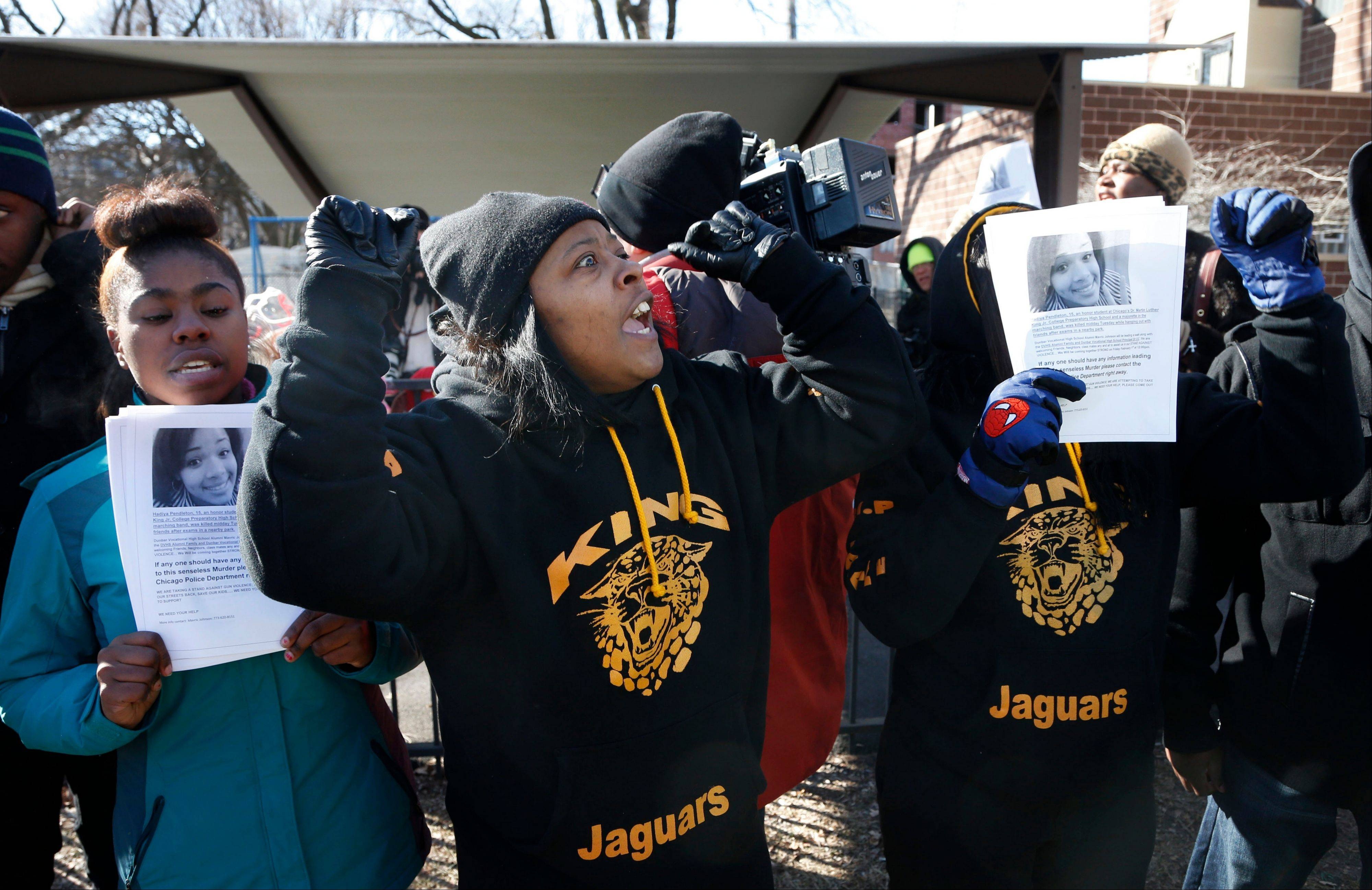 Anti-gun violence protesters rally Friday at the scene where Hadyia Pendleton was killed in Chicago.