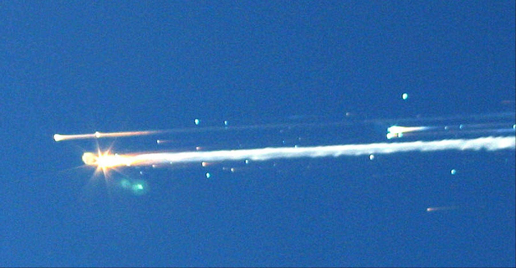 In this Feb. 1, 2003, photo, debris from the space shuttle Columbia streaks across the sky over Tyler, Texas. The Columbia broke apart in flames upon returning to Earth, killing all seven astronauts just minutes before they were to glide to a landing in Florida.