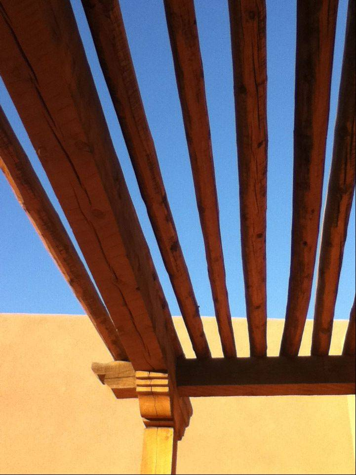 The lattice roof on a hotel room's balcony north of Albuquerque, New Mexico.