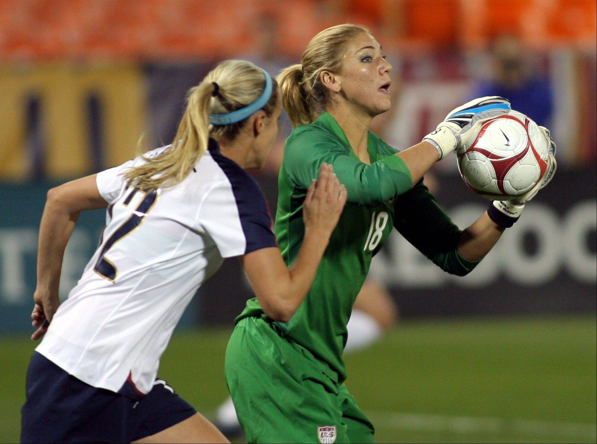 United States goalkeeper Hope Solo and Leslie Osborne, left, were teammates on the U.S. National Women's Team in 2008. Osborne has signed with the Chicago Red Stars for the 2013 NWSL season.