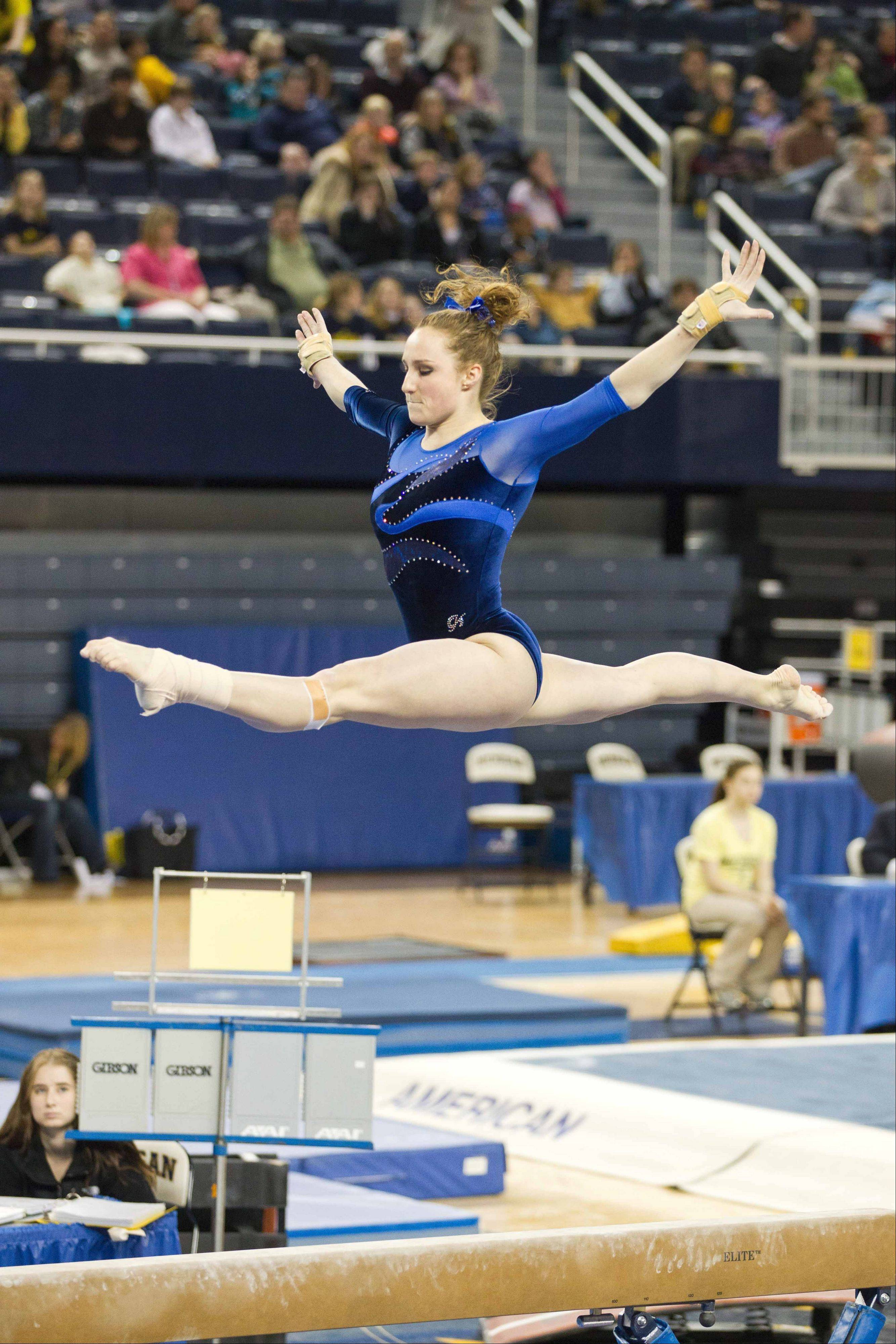 Michigan senior Katie Zurales, a Wheaton Warrenville South grad, has soared for the Wolverines this season on the balance beam and unever bars. A pre-med major, she wants to become a doctor when her college career ends.