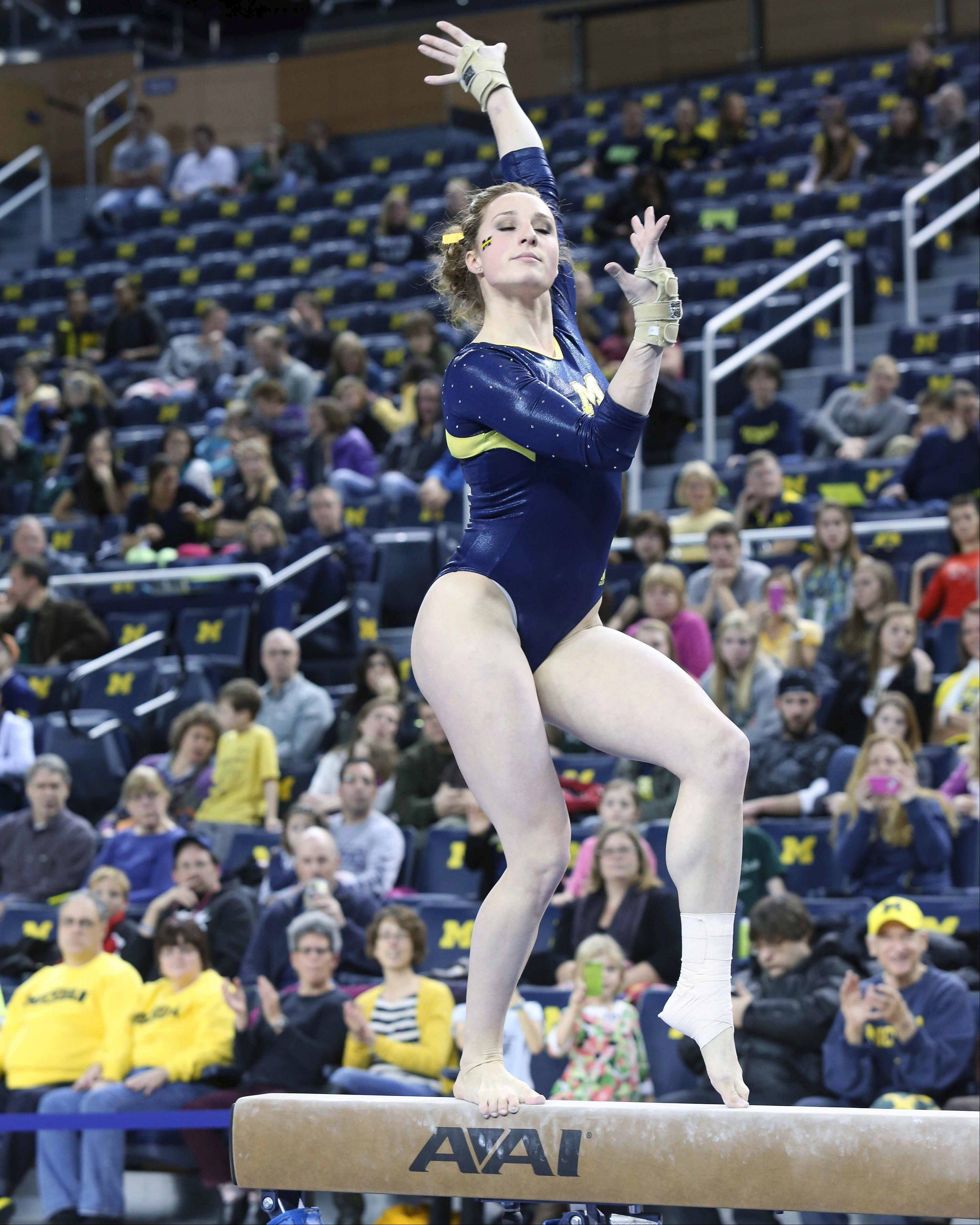 Michigan's three-time all-American gymnast, Katie Zurales of Wheaton Warrenville South, has helped the Wolverines become one of the top college teams in the country.