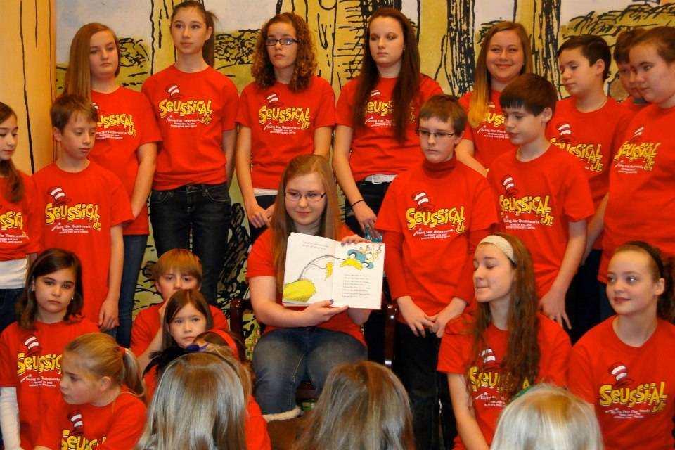 "The cast of Seussical Jr. by Rising Star Theatreworks read Dr. Seuss books and sang songs from the musical during storytime at Barnes & Noble in the Geneva Commons in January. Reading ""Green Eggs and Ham"" is cast member Jill Danklefsen."