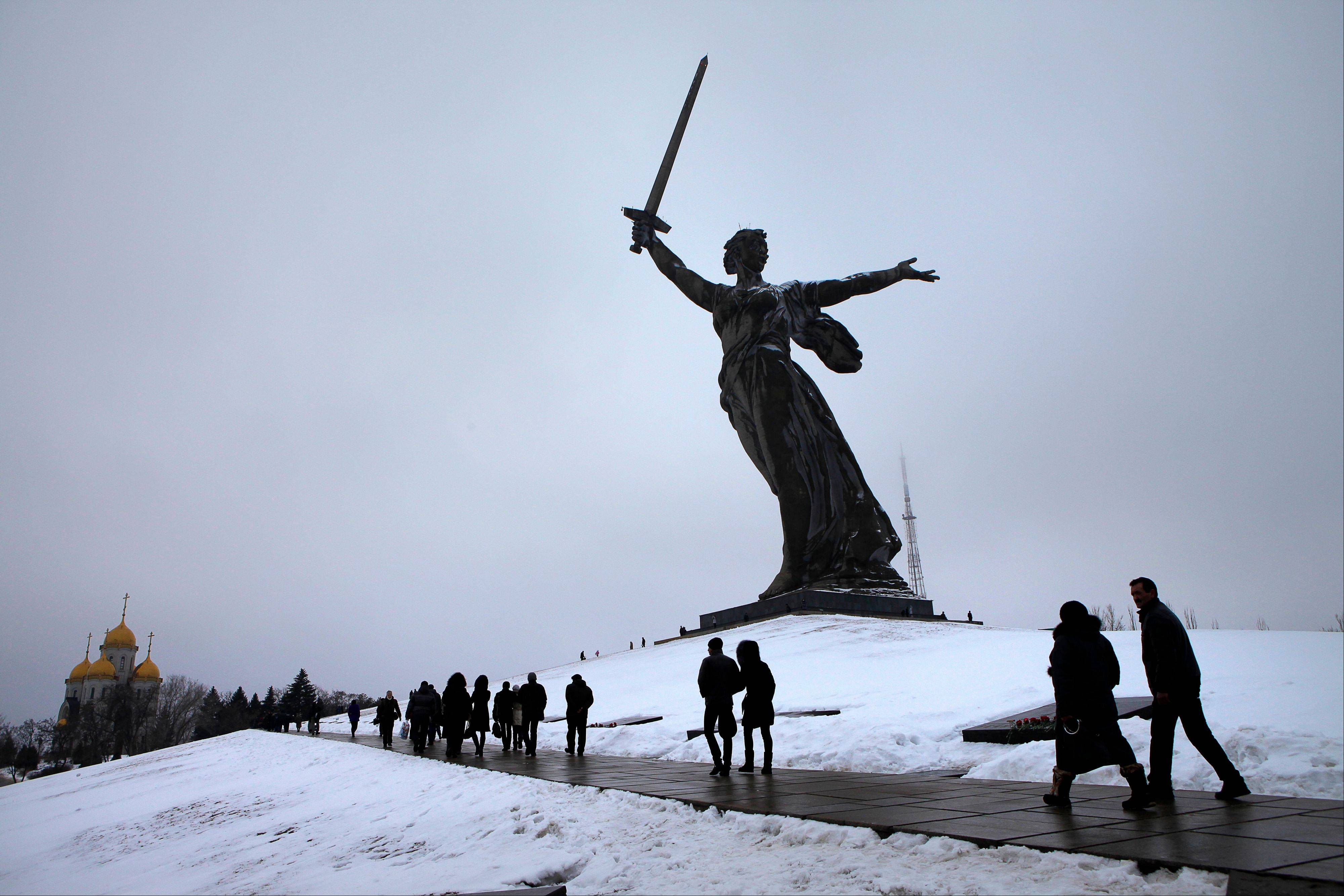 People walk past the monument to Motherland Saturday during ceremonies marking the 70th anniversary of the Battle of Stalingrad in the southern Russian city of Volgograd, once known as Stalingrad.