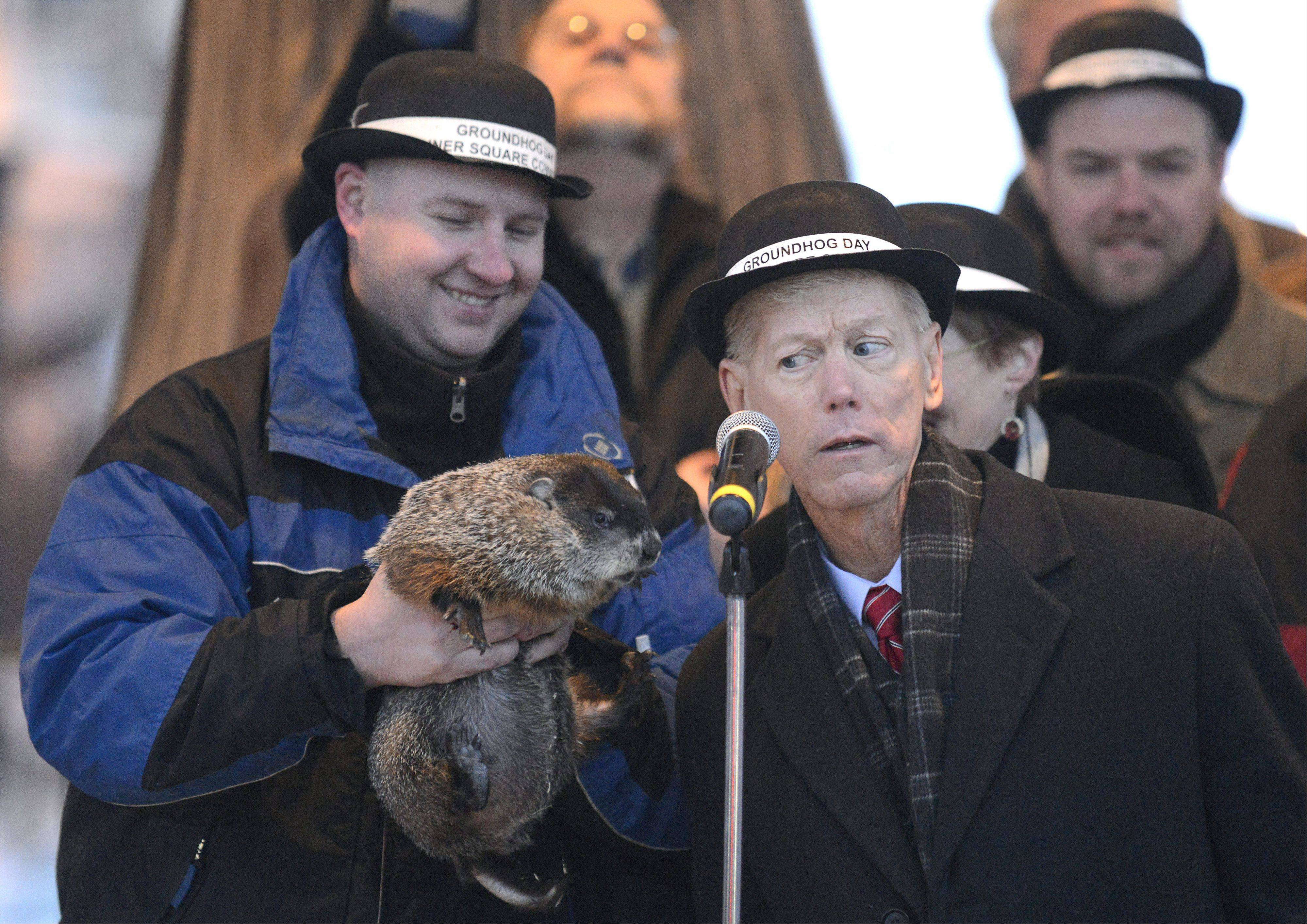 Woodstock Mayor Brian Sager listens to what Woodstock Willie has to say as his handler Mark Szaran of Chicago holds him to the microphone on Groundhog Day in Woodstock Square Saturday. Willie did not see his shadow, meaning we�re in for an early spring.