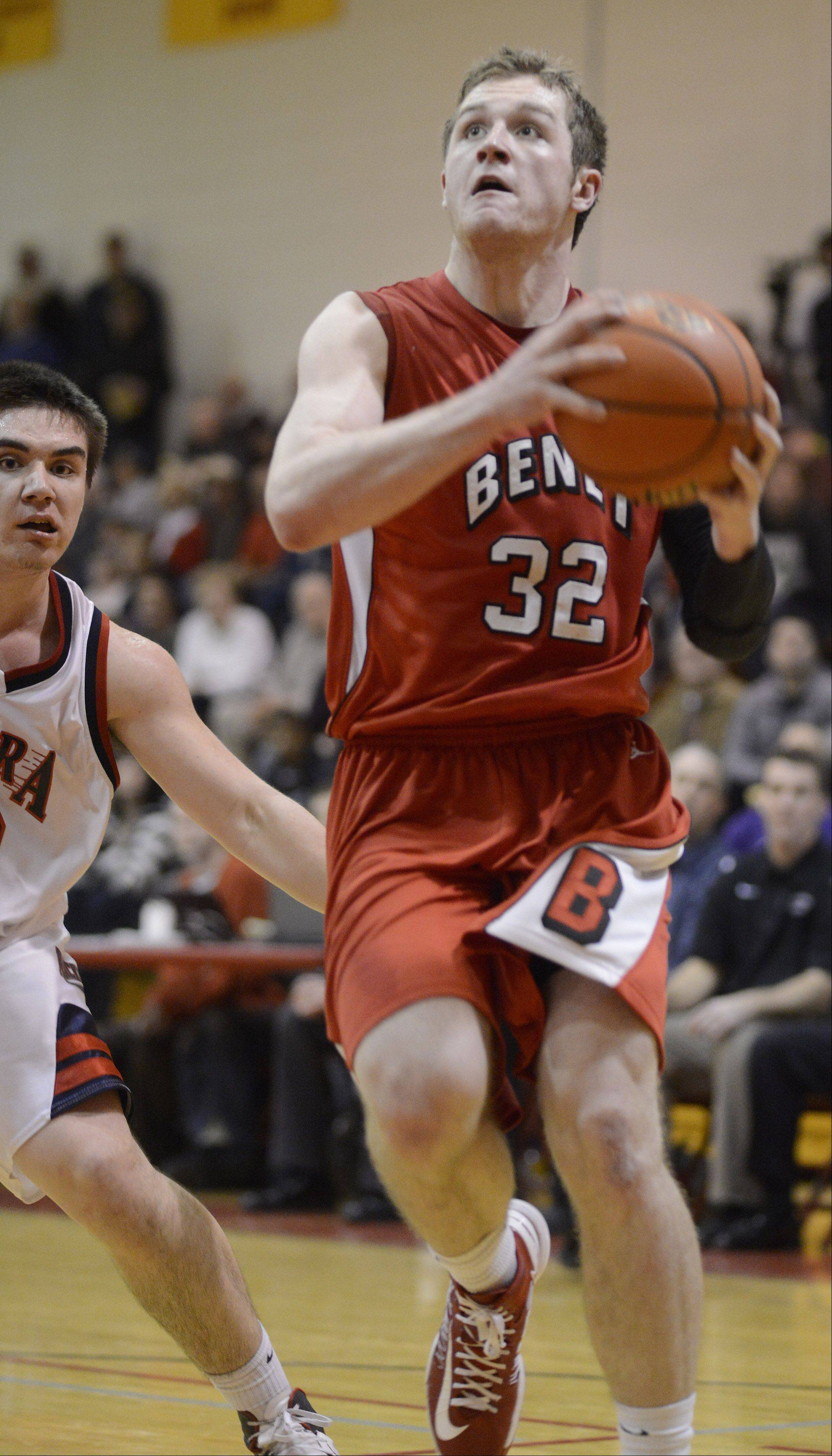 Benet Academy�s Pat McInerney drives to the basket against West Aurora during the 20th anniversary Night of Hoops at Batavia High School Saturday night.