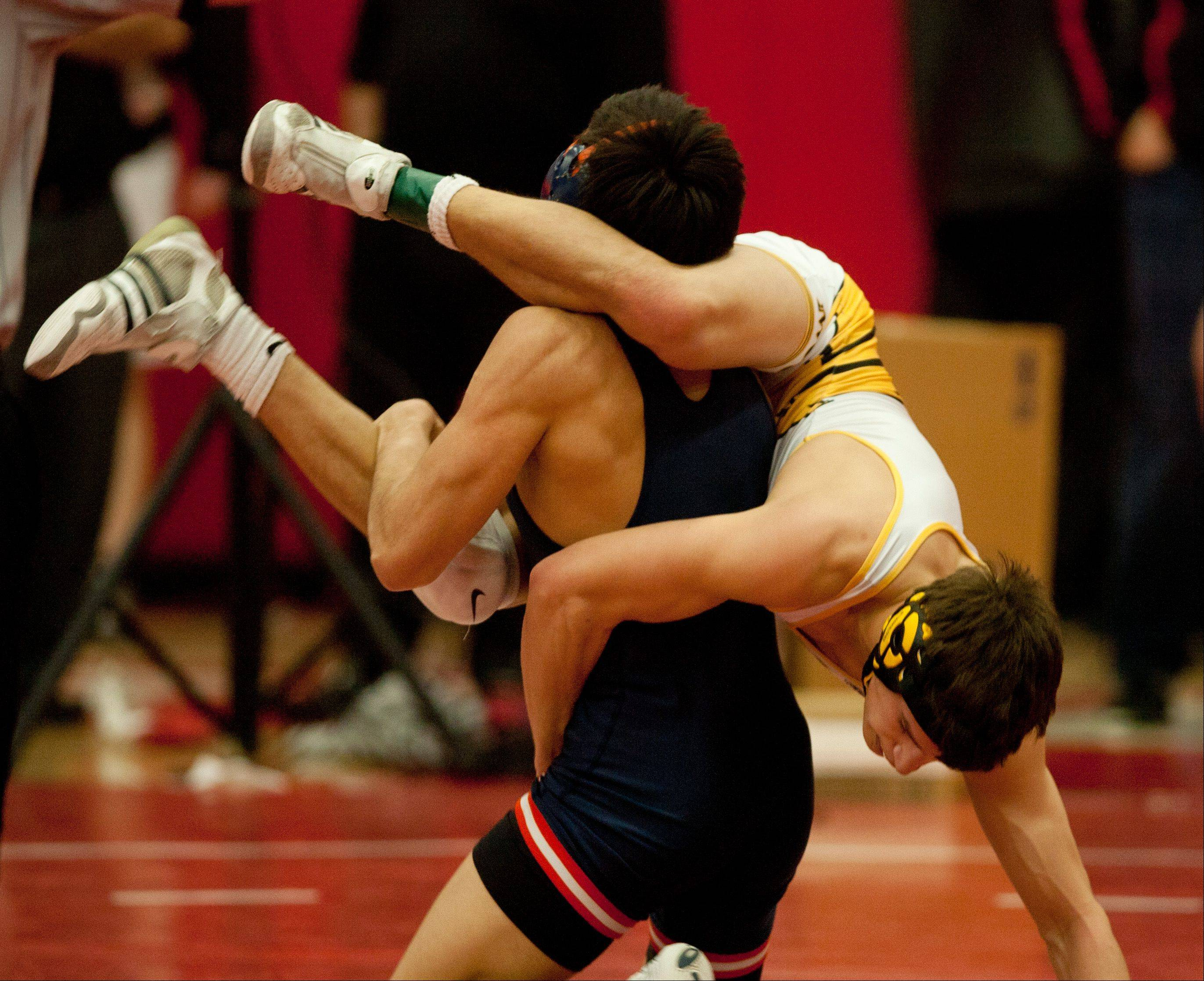 Metea Valley�s Kenan Carter hangs on for a 6-3 win over Naperville North�s Joe Knurek in the 126-pound class of the Class 3A Naperville Central Wrestling Regional.