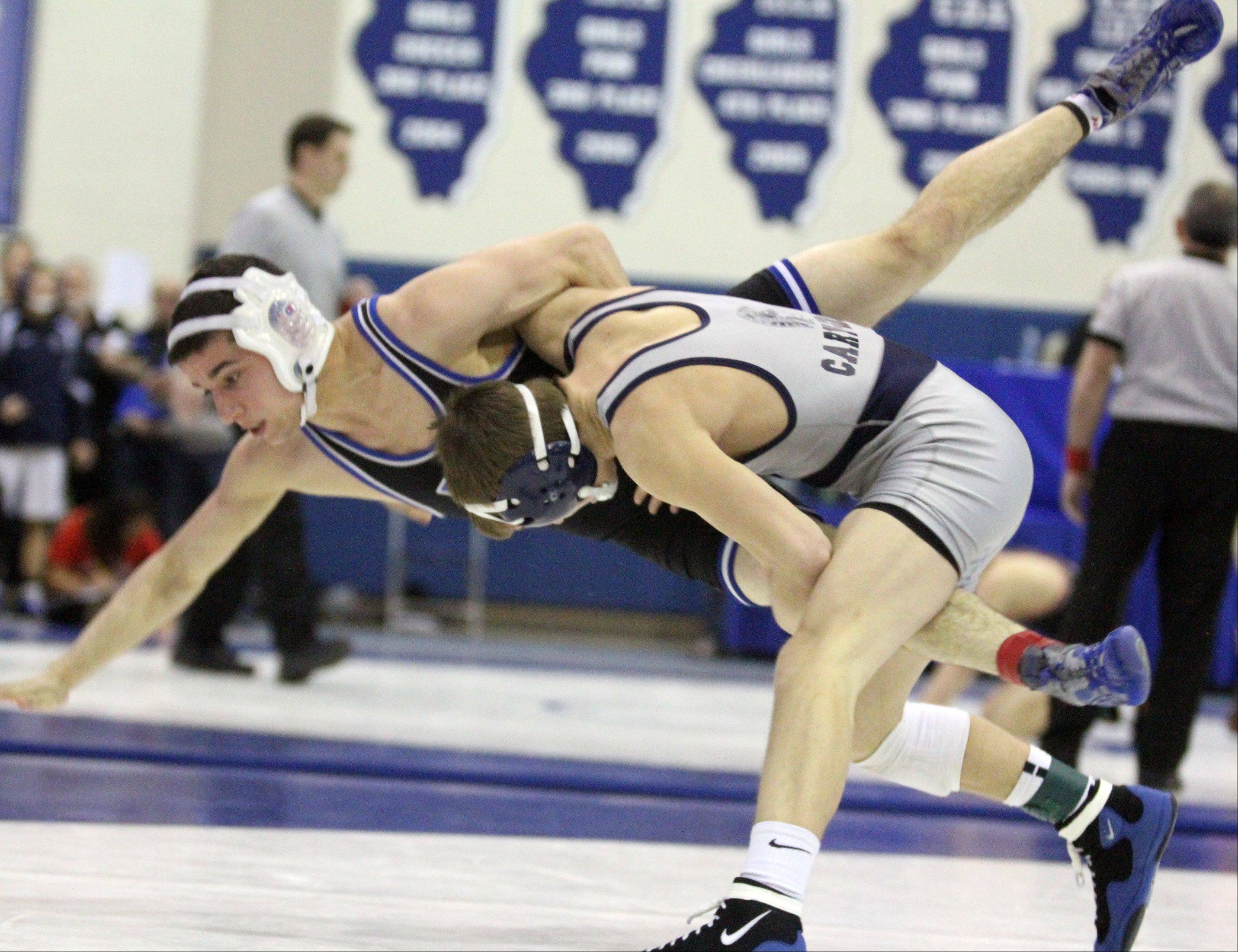 George LeClaire/gleclaire@dailyherald.com Cary-Grove's Michael Cullen, right, wins his 113-pound championship match against Highland Park's Nate Kessler at the Class 3A individual wrestling regional at Lake Zurich on Saturday, February 2, 2013.