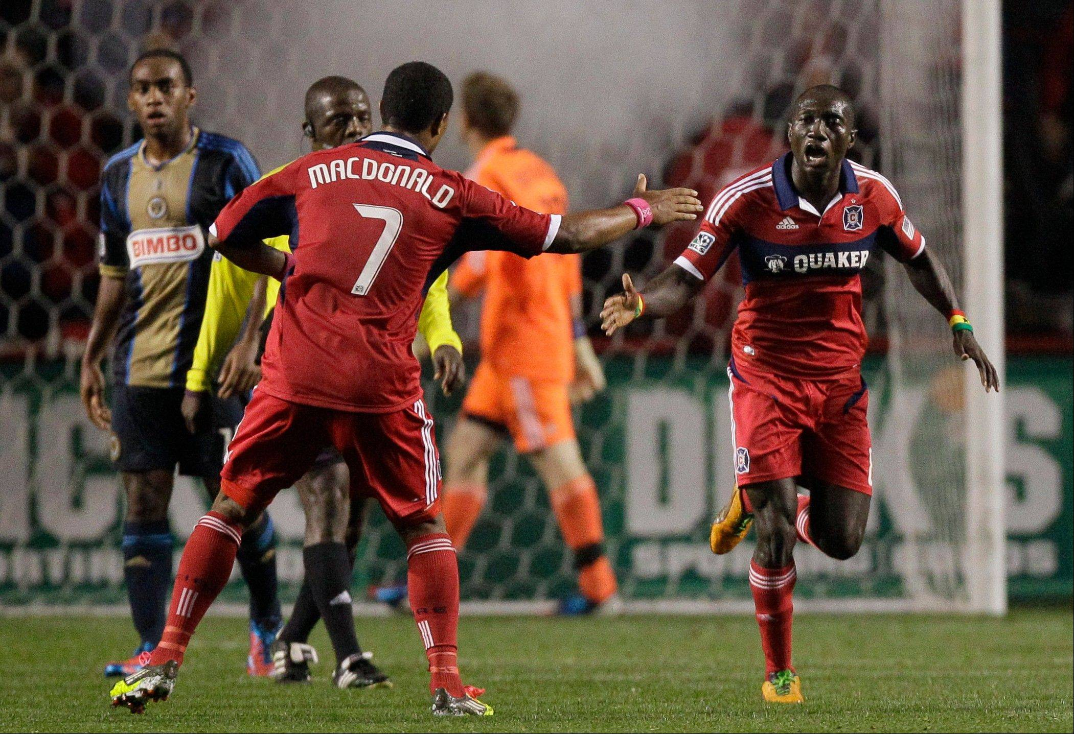 Chicago Fire forward Dominic Oduro, right, celebrates with forward Sherjill McDonald (7) after scoring a goal during the second half of an MLS soccer game against the Chicago Fire, Wednesday, Oct. 3, 2012, in Bridgeview, Ill. The Union won 3-1. (AP Photo/Nam Y. Huh)