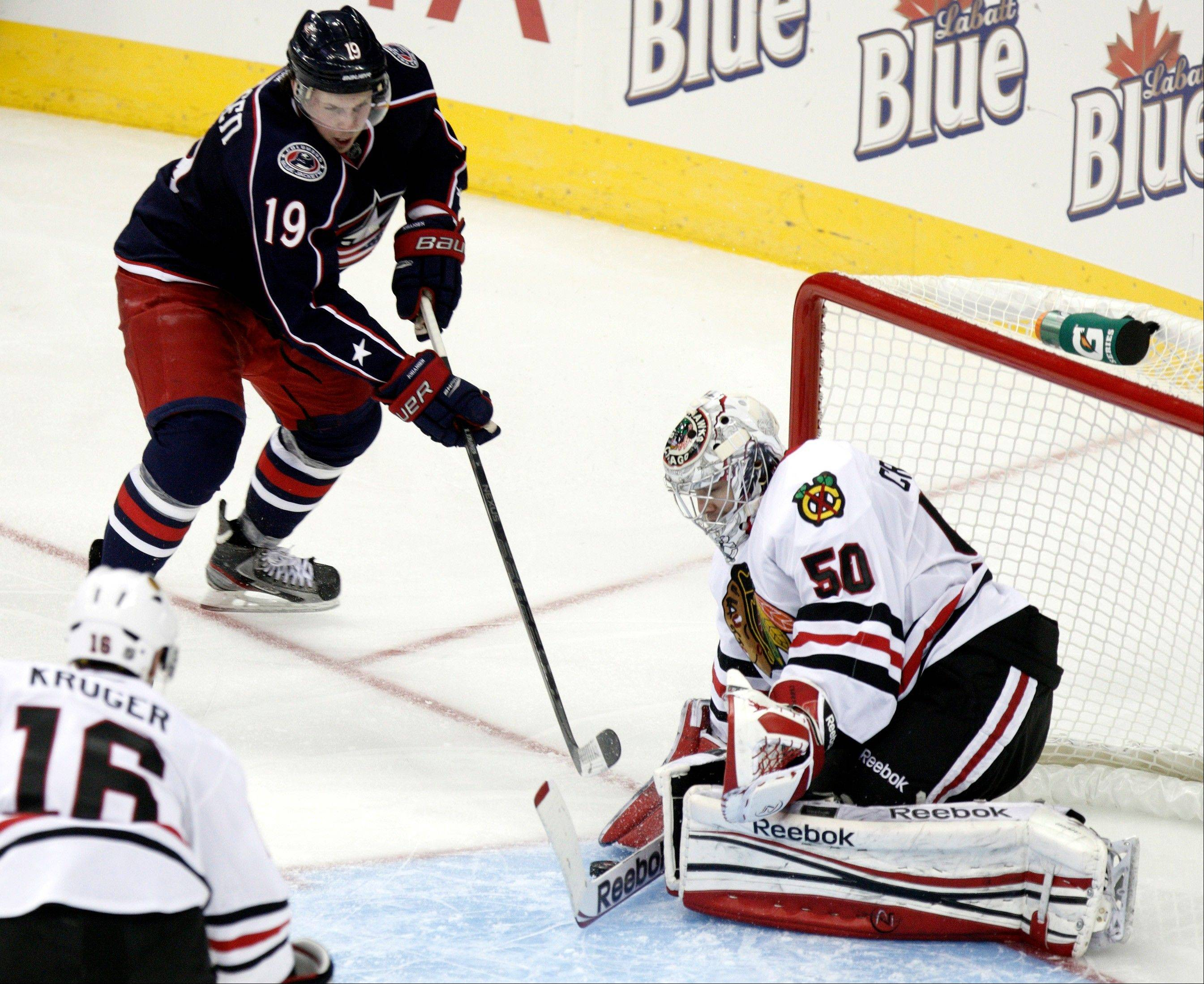 Chicago Blackhawks goalie Corey Crawford stops a shot against Columbus Blue Jackets' Ryan Johansen in the third period of an NHL hockey game in Columbus, Ohio, Saturday, Jan. 26, 2013. Chicago won 3-2. (AP Photo/Paul Vernon)