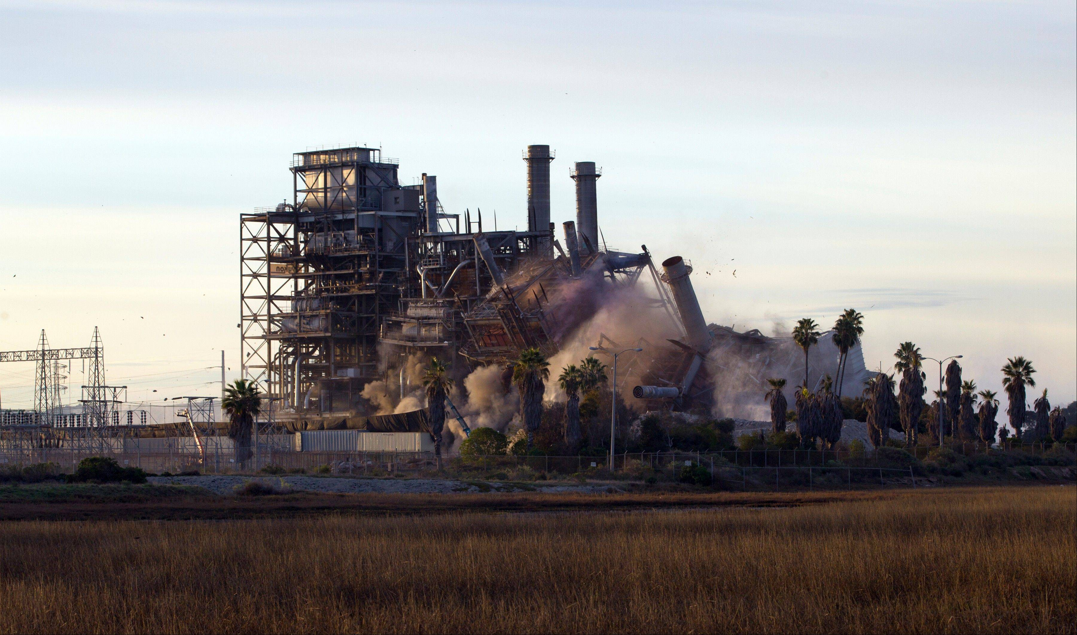 The South Bay Power Plant collapses Saturday after imploding.