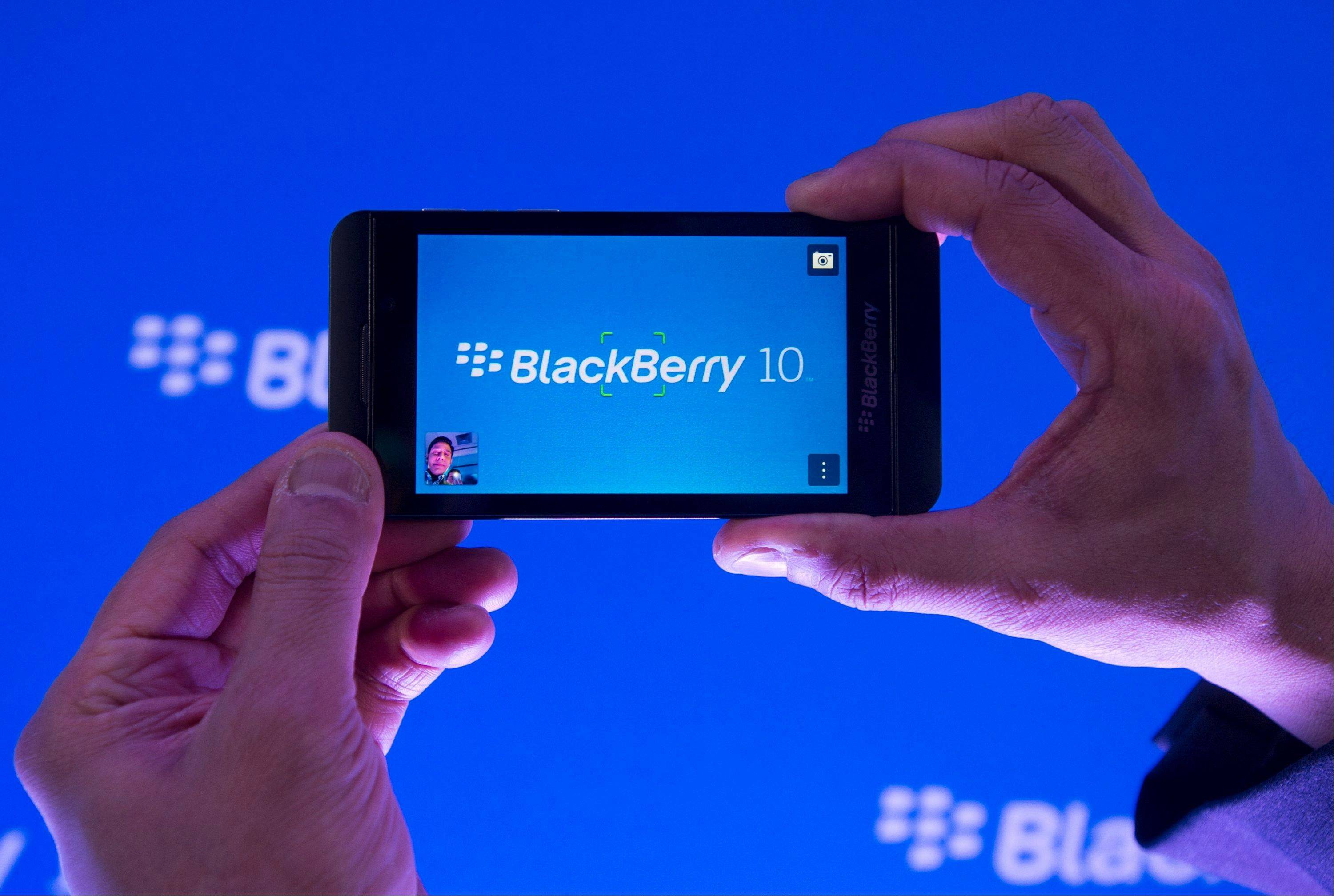 Arun Kumar, a senior product manager for BlackBerry, shows off the new BlackBerry Z10 Wednesday during the global launch of the new Blackberry smartphones in Toronto. BlackBerry is promising a speedy browser, a superb typing experience and the ability to keep work and personal identities separate on the same phone, the fruit of a crucial, long-overdue makeover for the company.